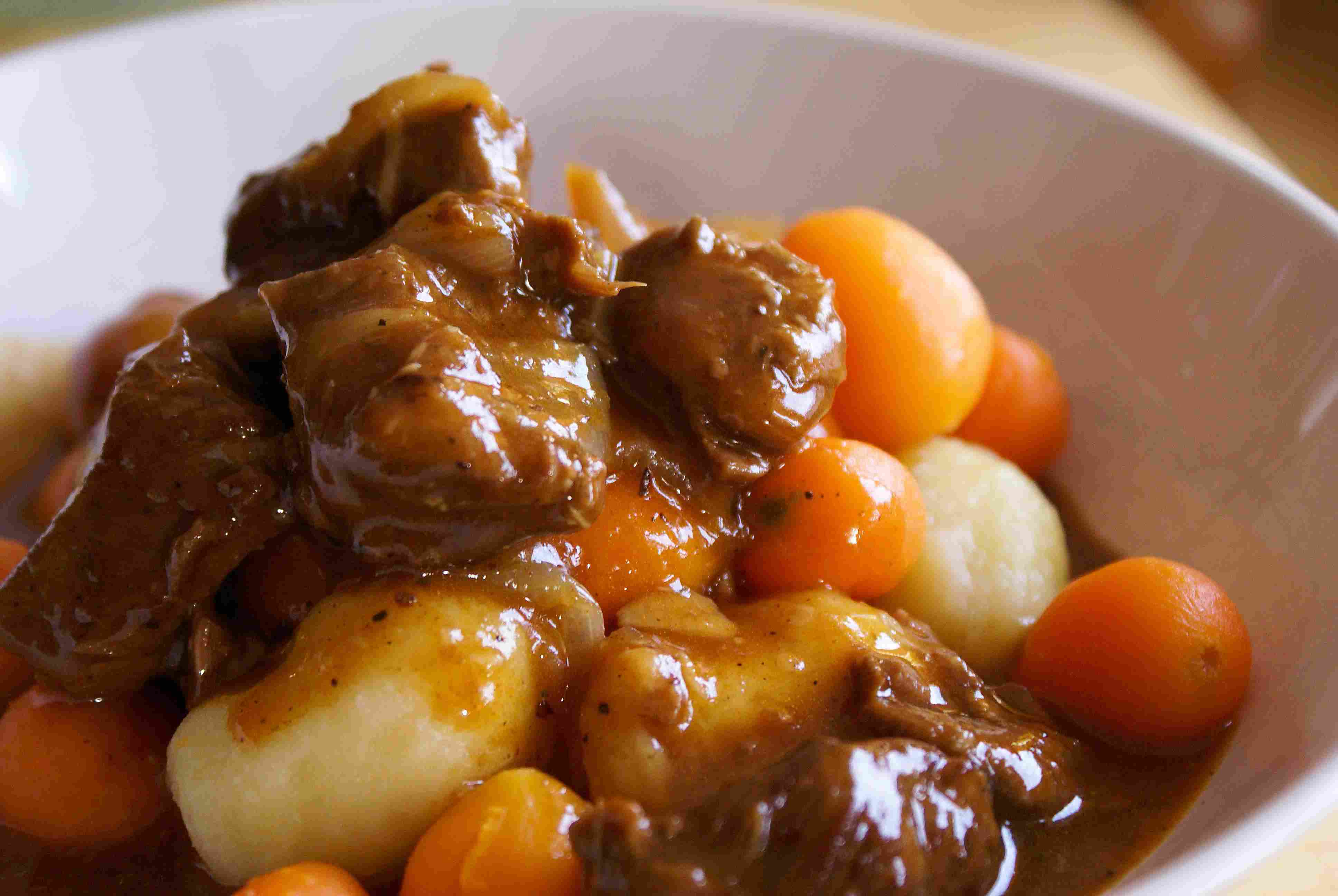 Beef stew with small dumplings and carrots