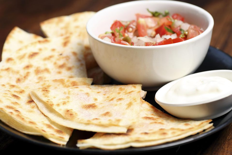 Veggie quesadillas, served with salsa and sour cream