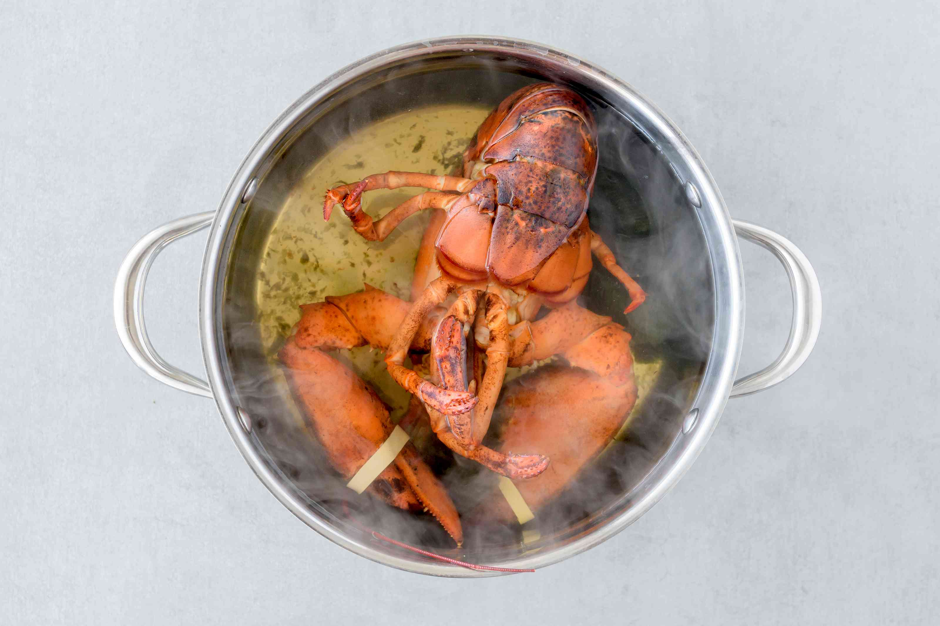Put lobsters into pot