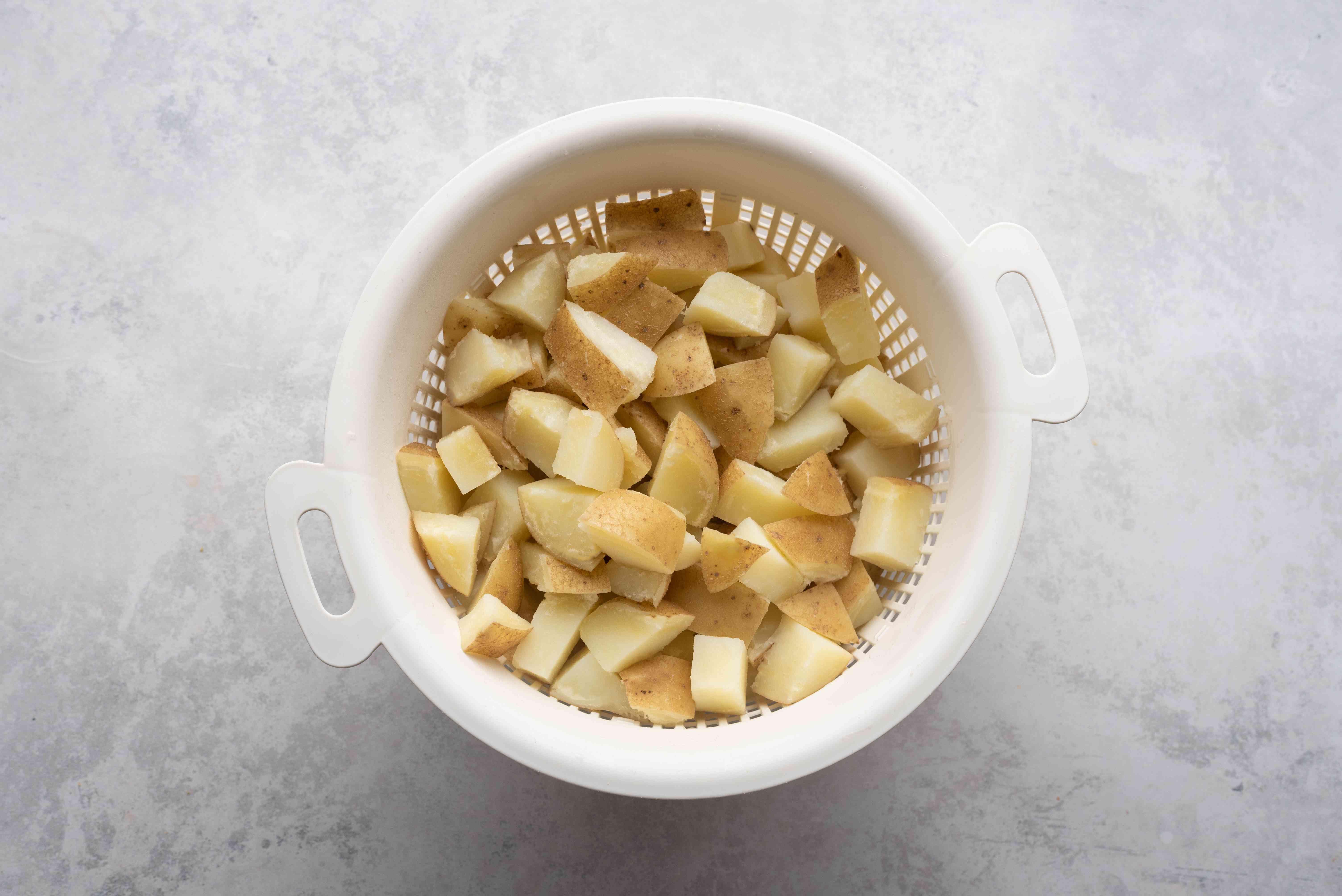 Drain potatoes in a colander