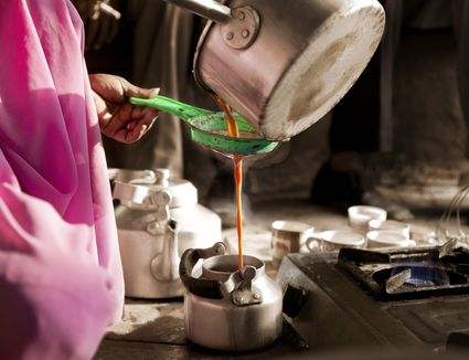 Pouring chai in kettle
