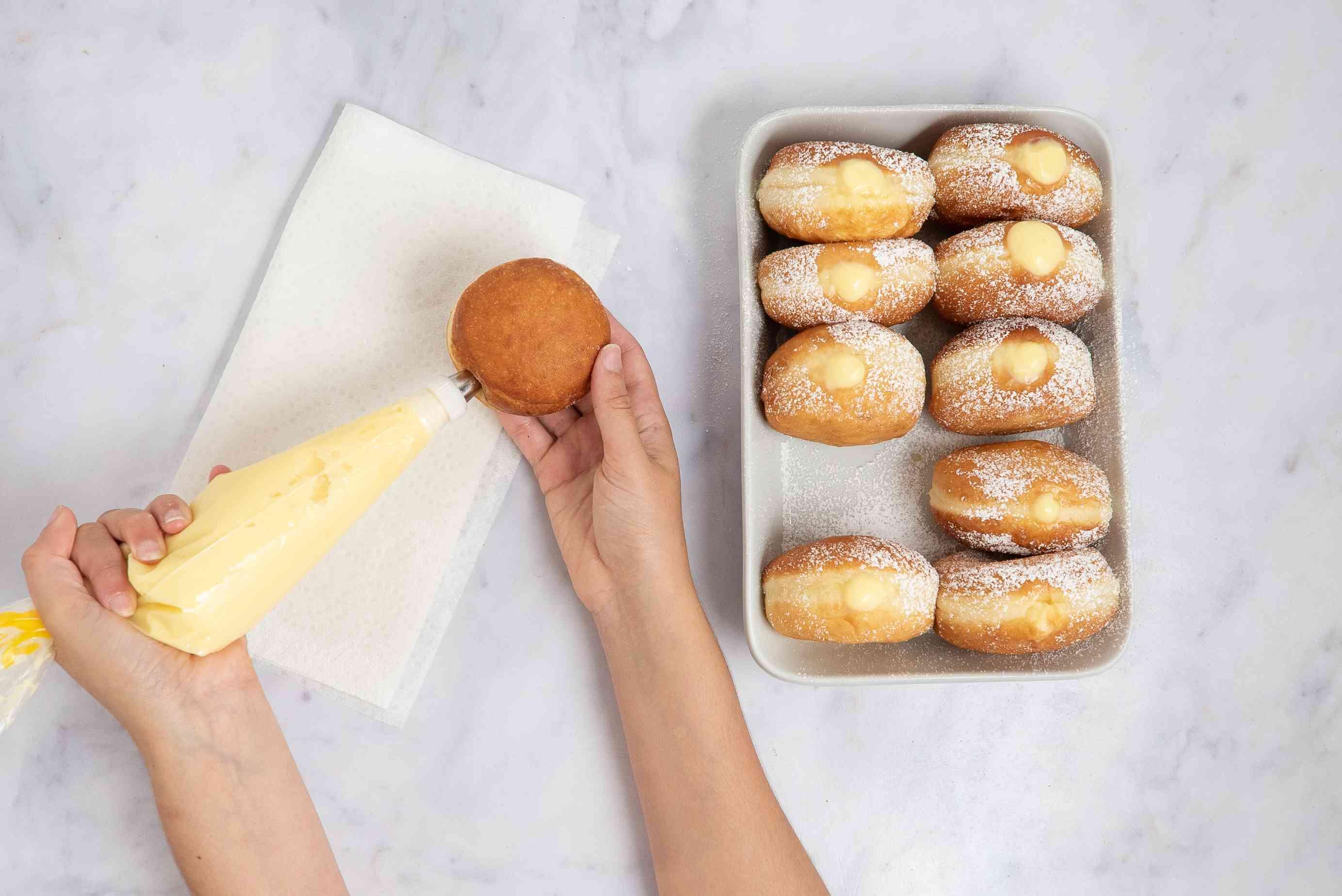 pipe cream into doughnuts