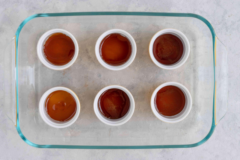 Carefully spoon carmelized sugar in