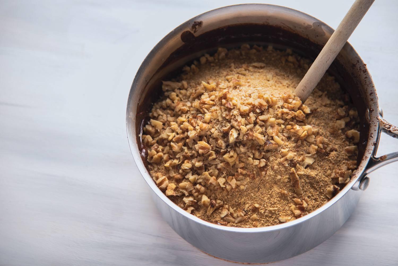 Stir in graham cracker crumbs and walnuts