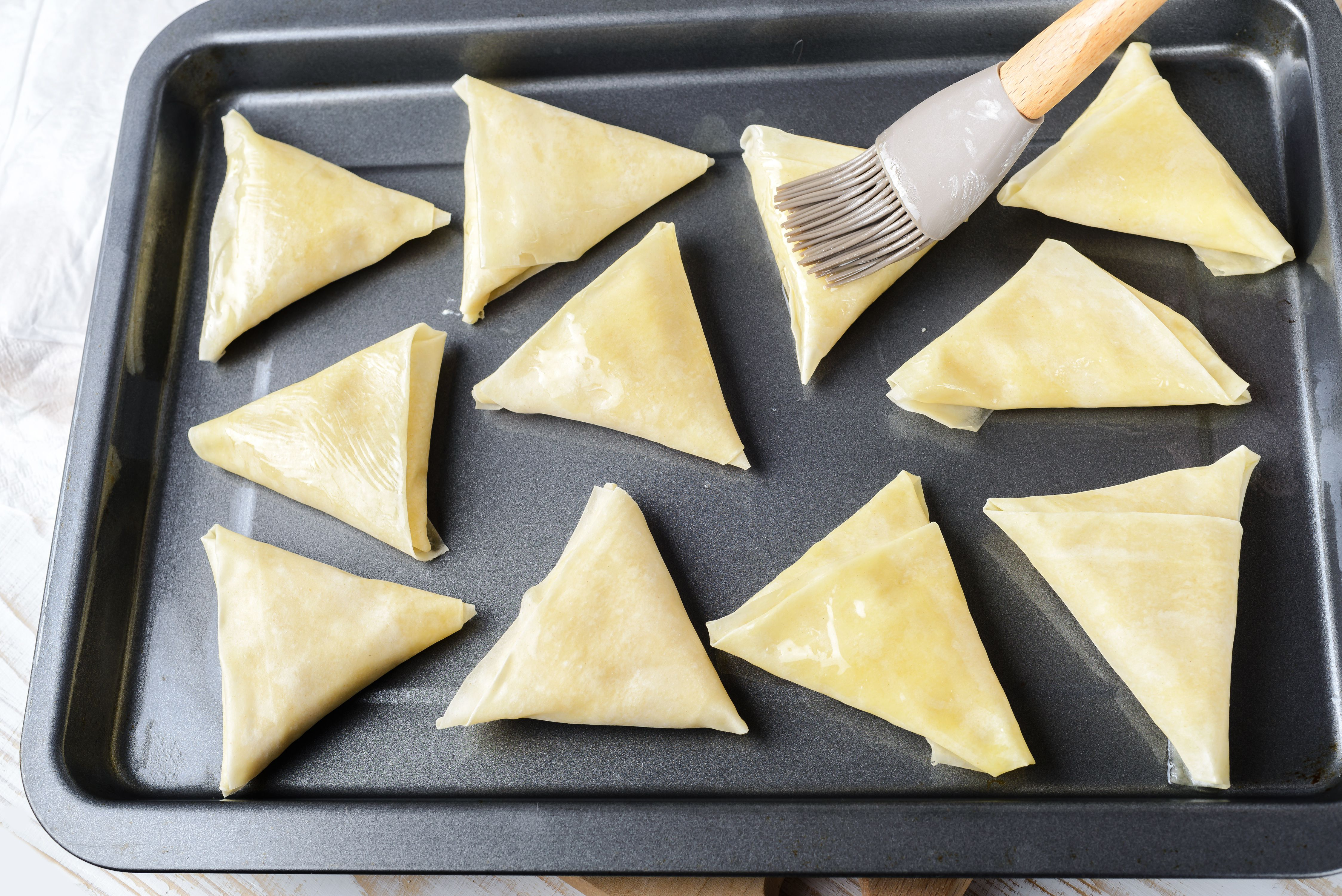 Brush triangles with butter