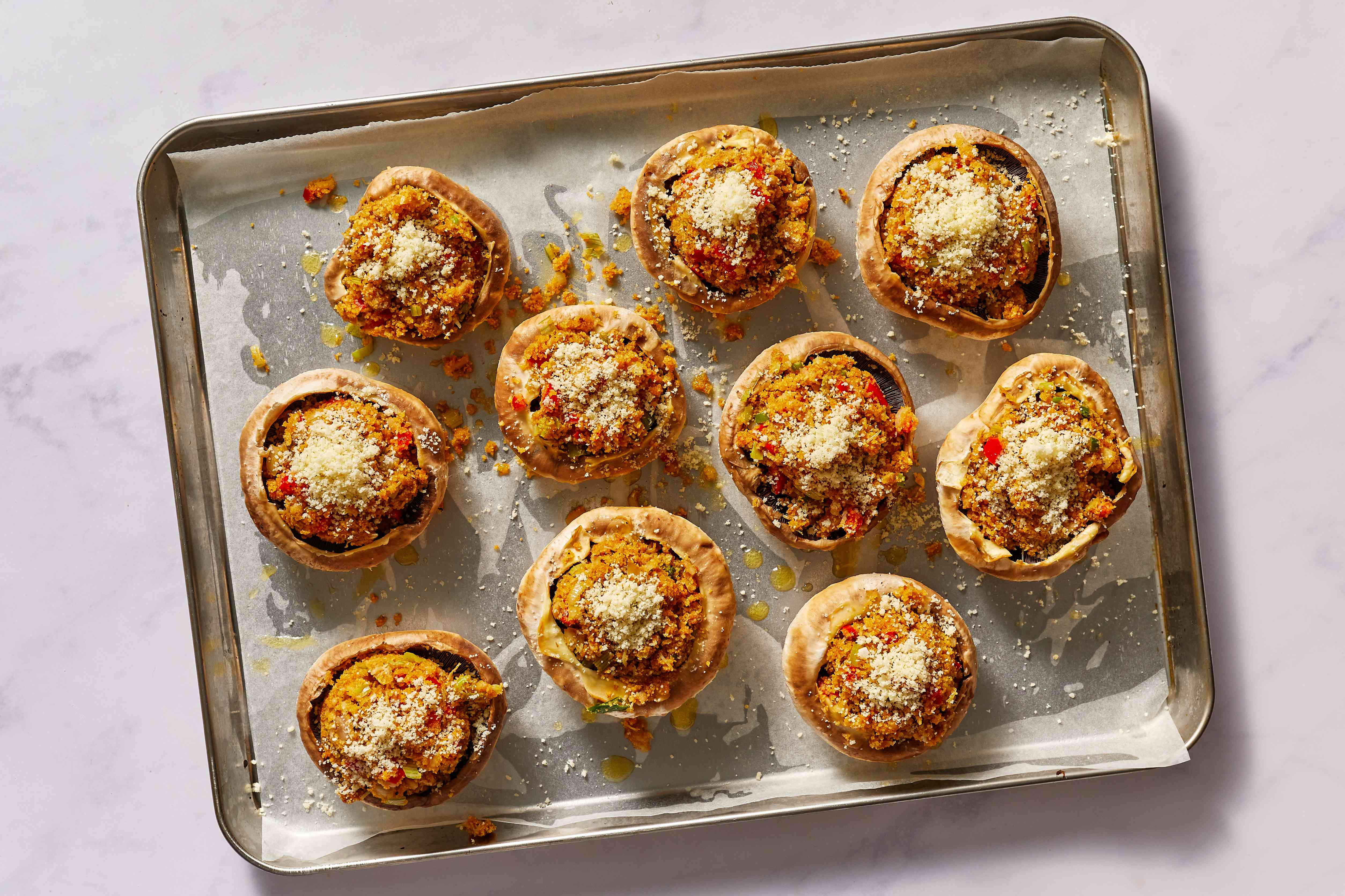 Sprinkle each filled mushroom cap with a little Parmesan cheese