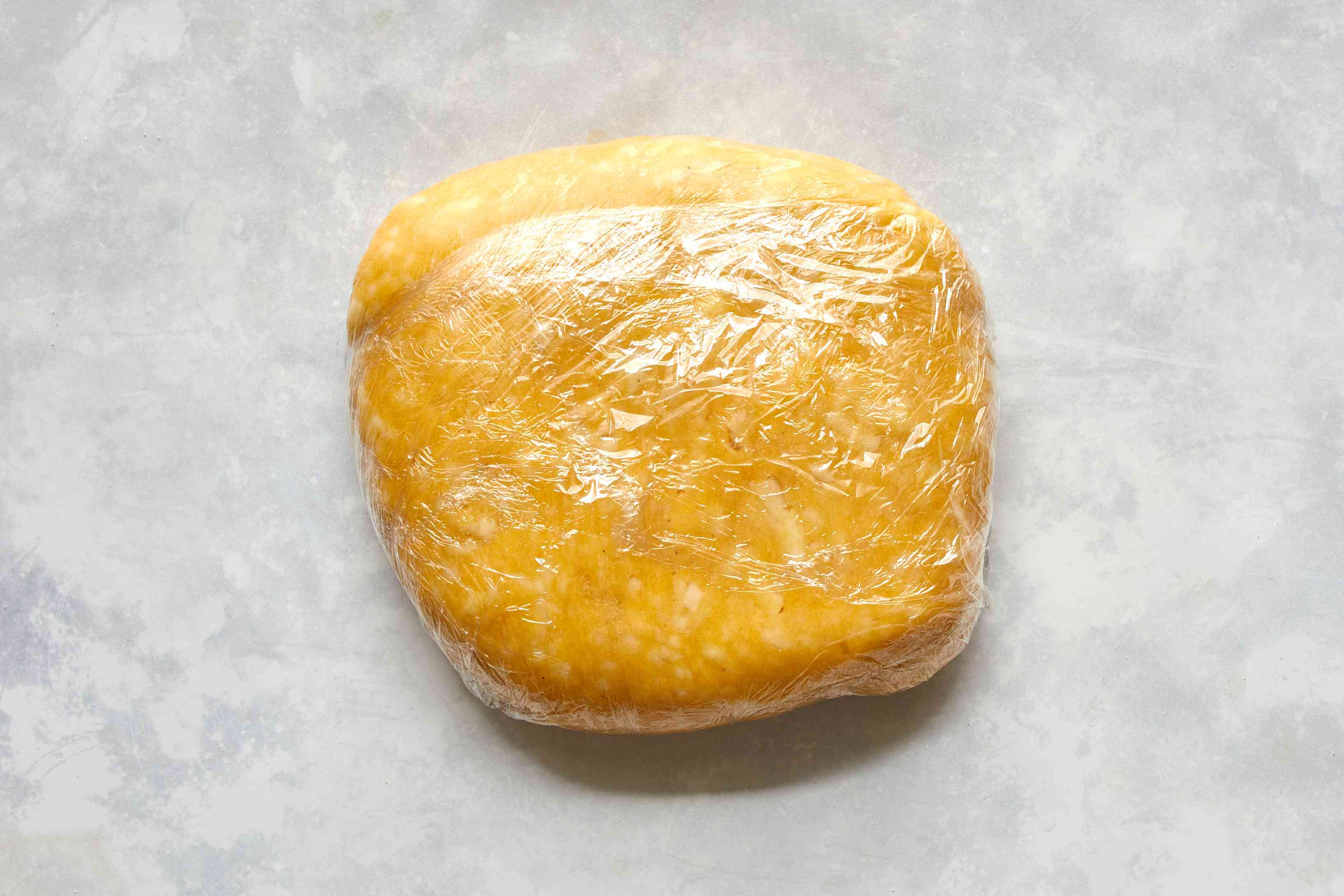 Colombian cheese bread dough in plastic wrap