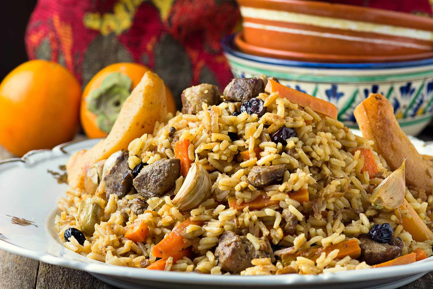 Traditional middle eastern dish - plov (pilaf) with rice, quince, lamb meat and carrots.