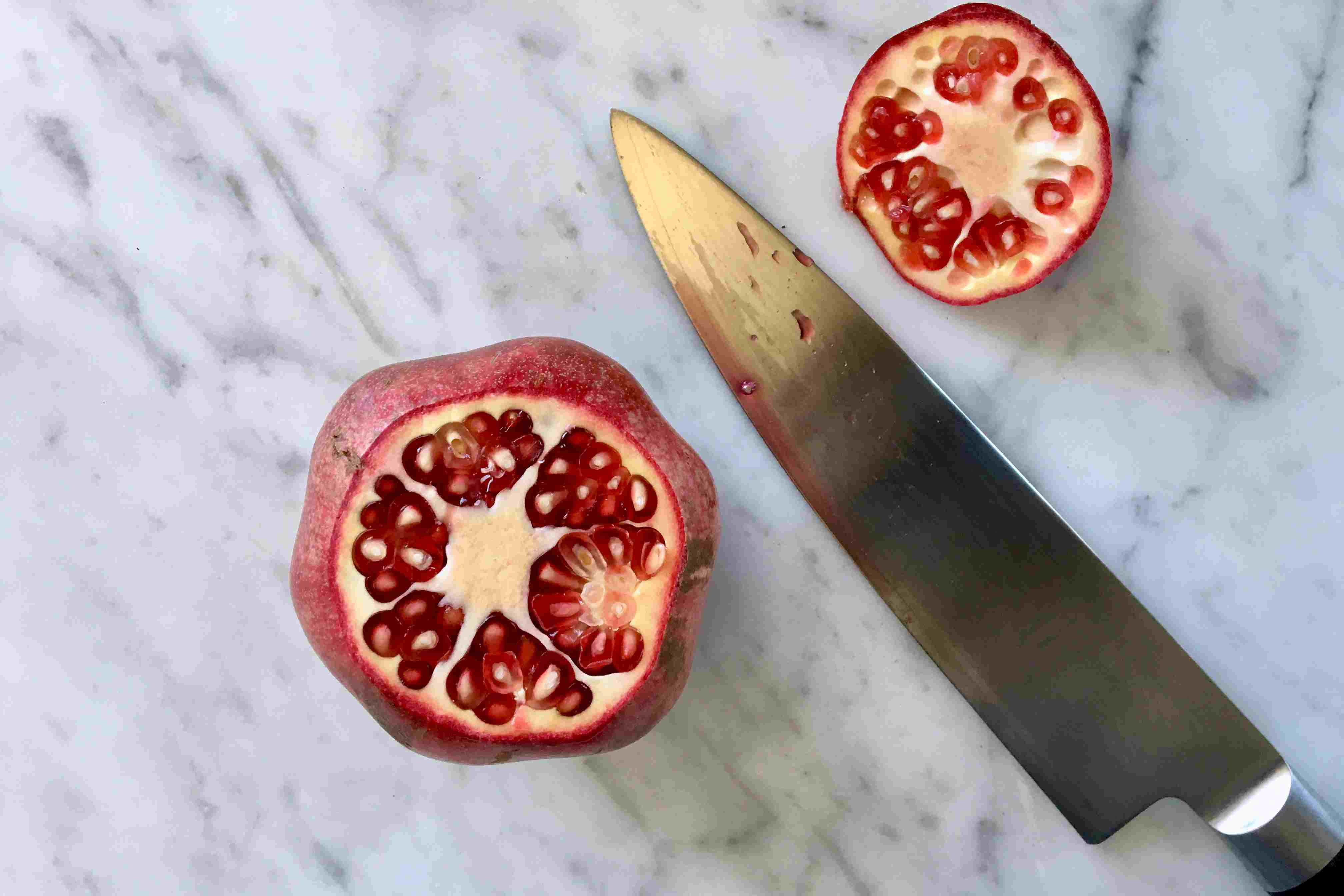Cut the top off the pomegranate