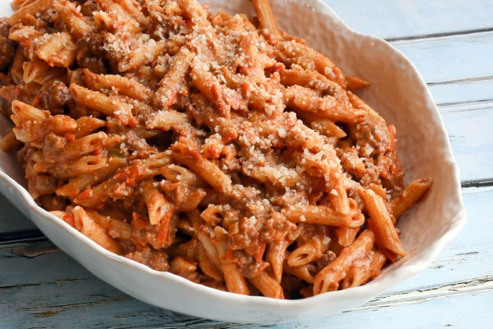Penne pasta with creamy tomato and meat sauce