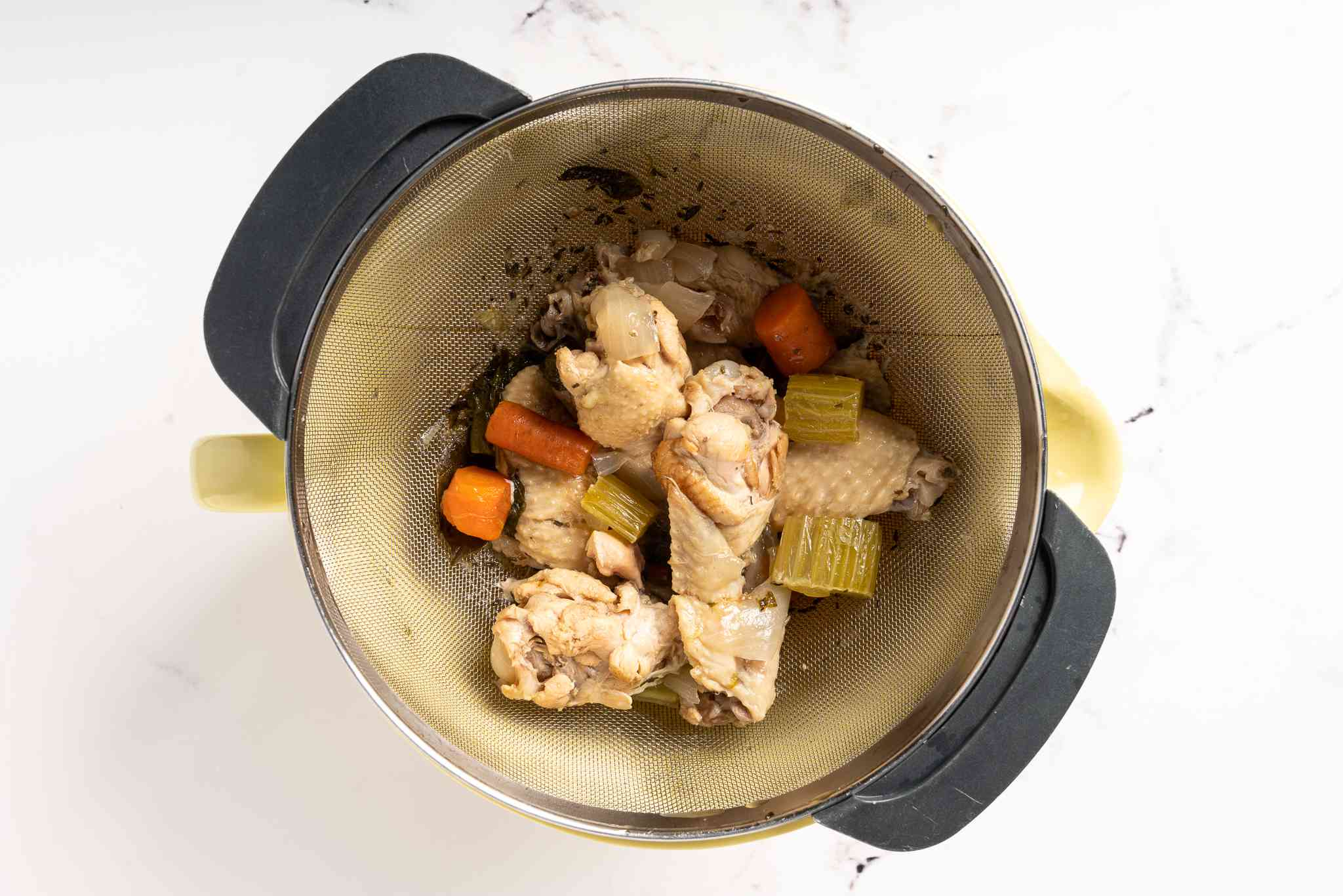 strain the liquid from the chicken and vegetables