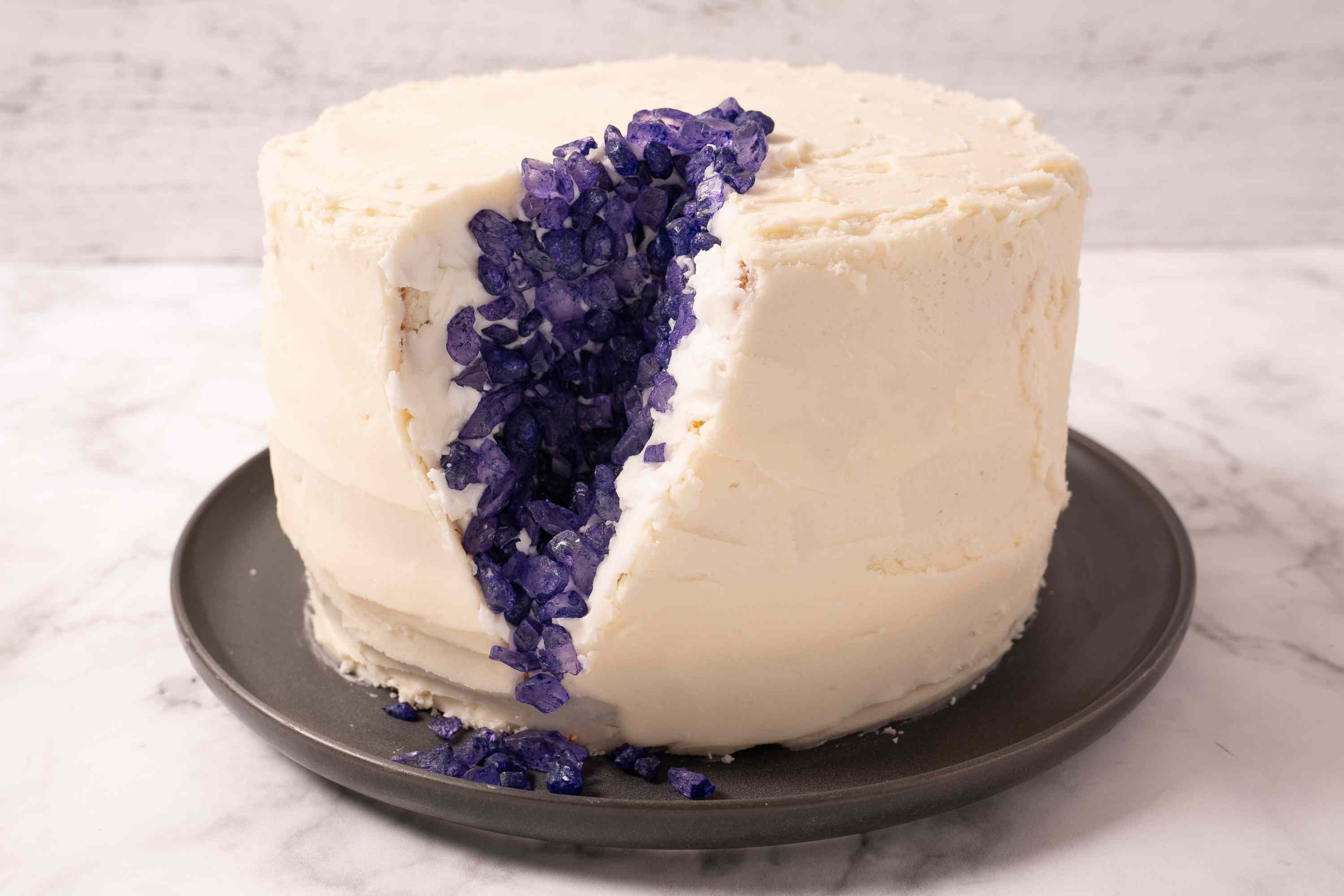Cake crevasse frosted and studded with purple rock candy