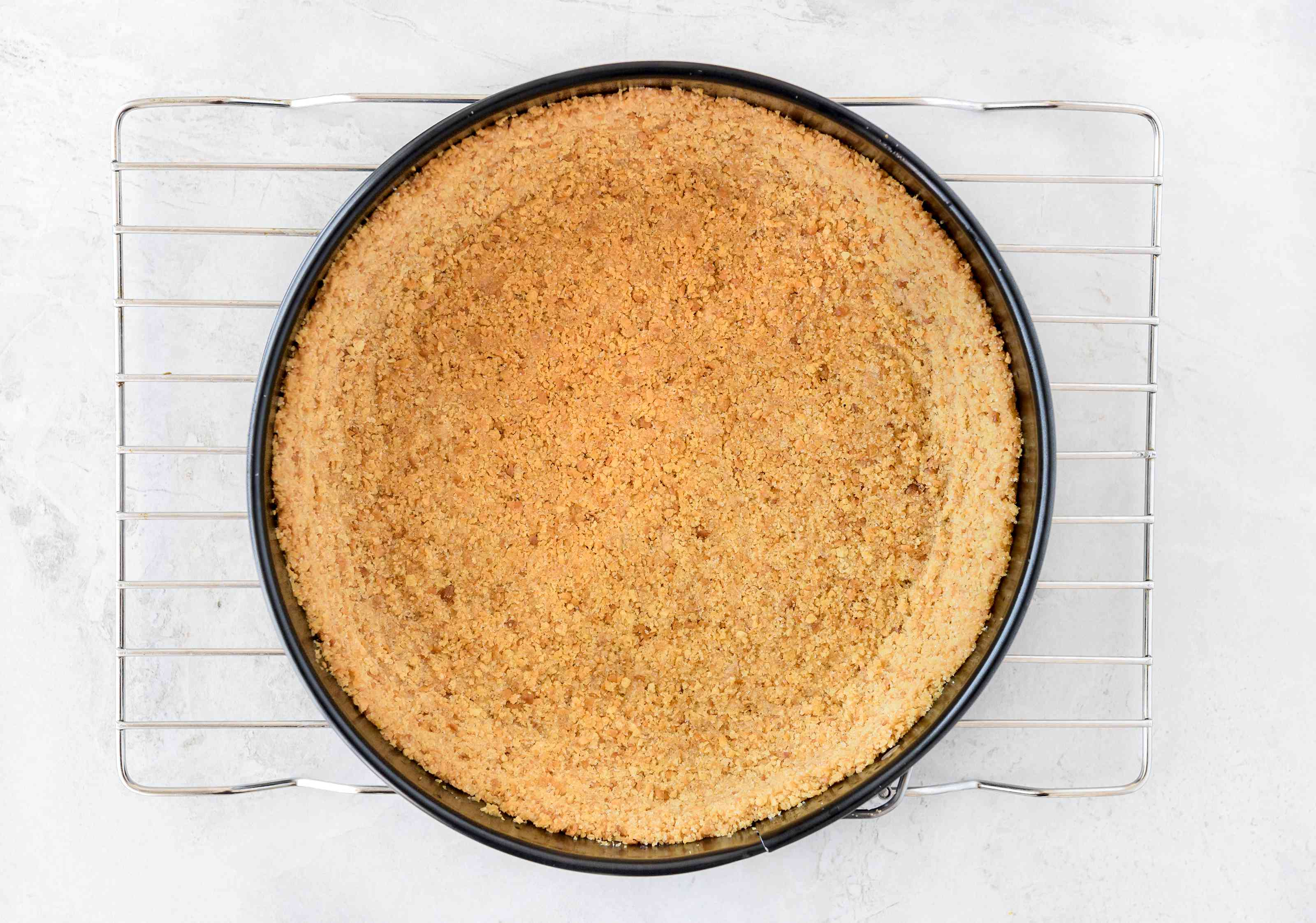 Dairy-free cheesecake crust on cooling rack