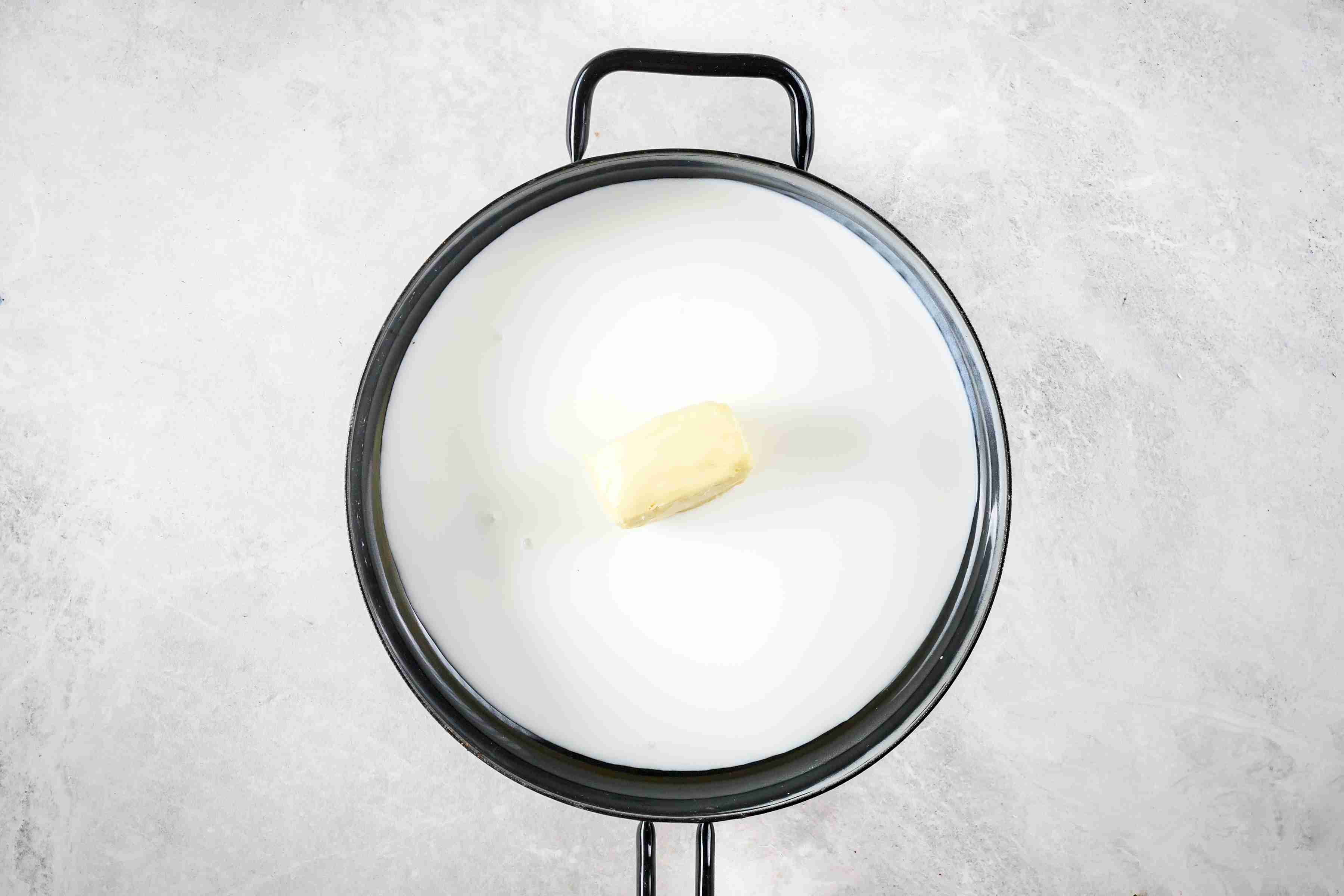 Butter and cream melting in a sauté pan