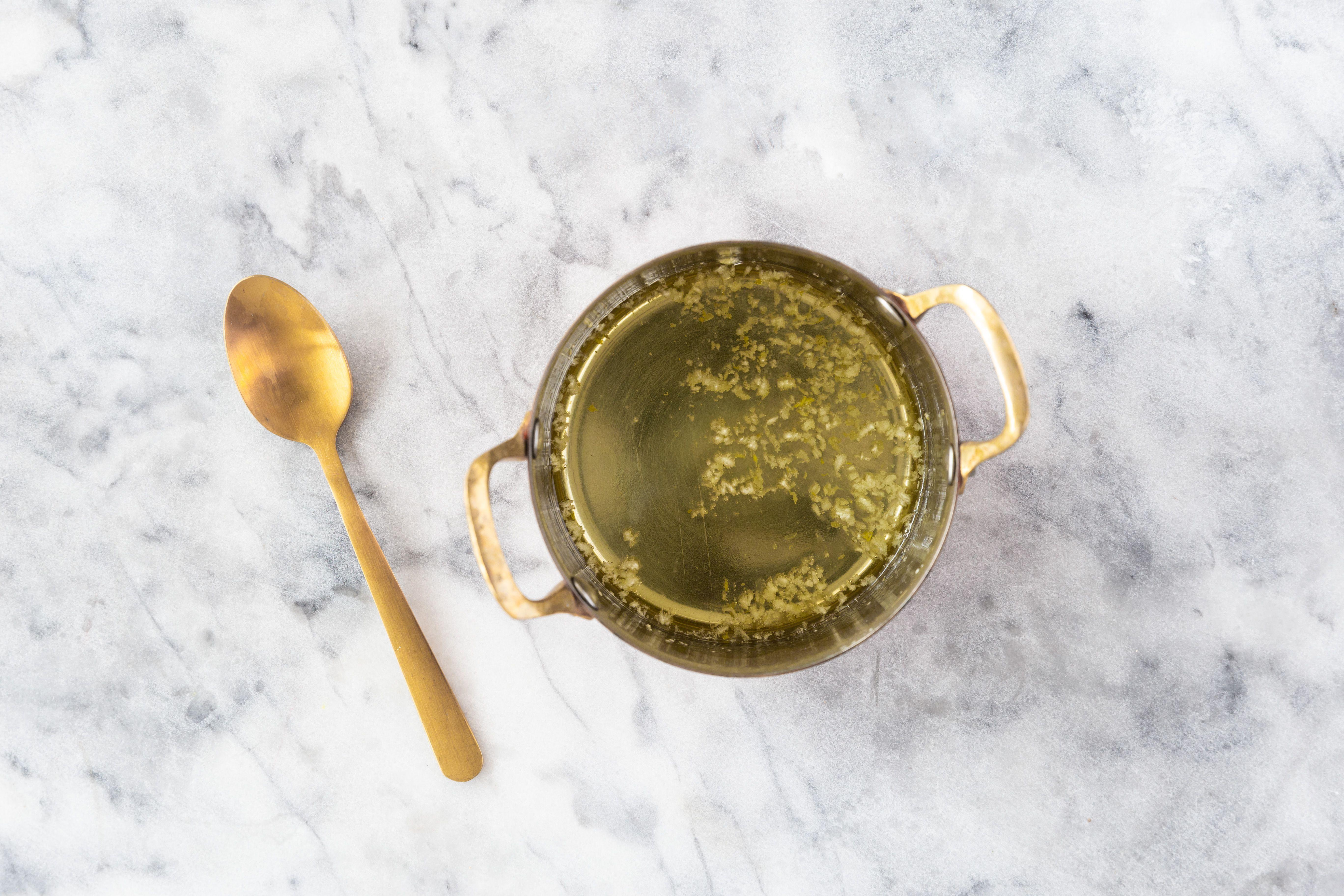 Garlic-infused oil in pan