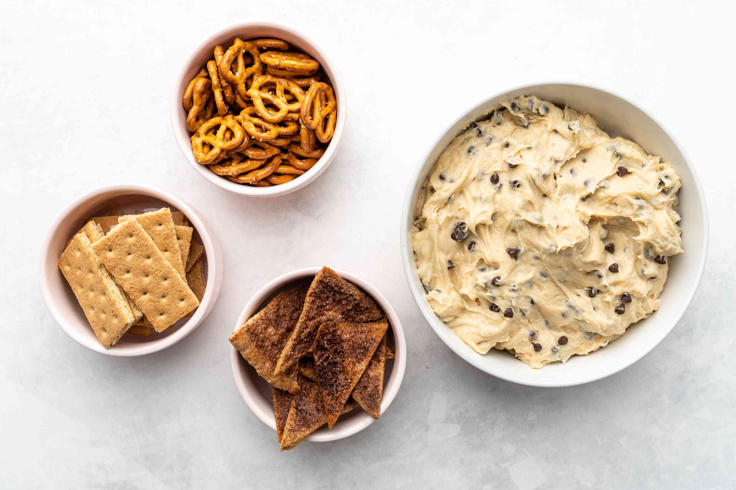 Chocolate Chip Cookie Dough Dip served with crackers, pretzels, and pita chips
