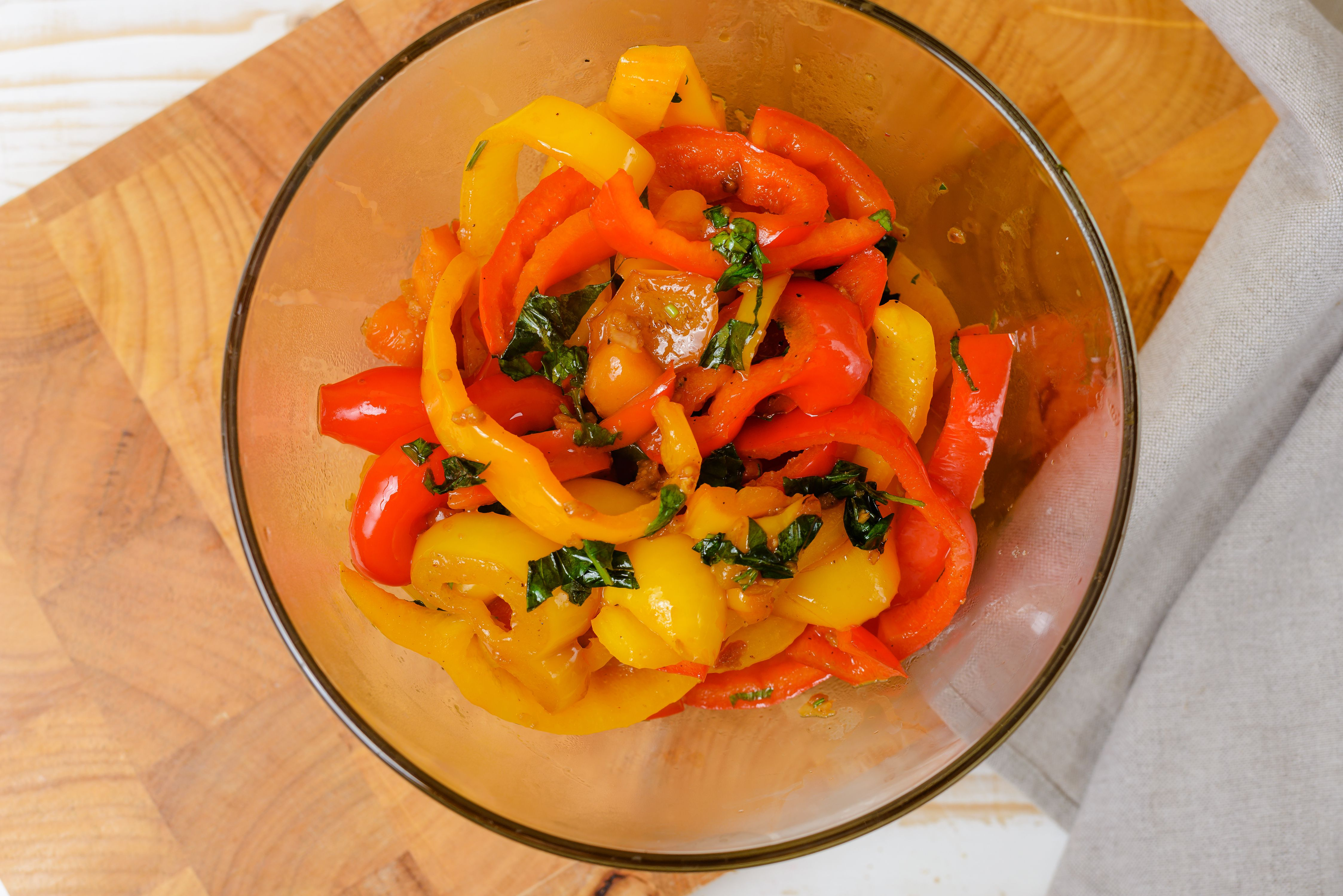 Garlic and herb sautéed bell pepper strips in a bowl