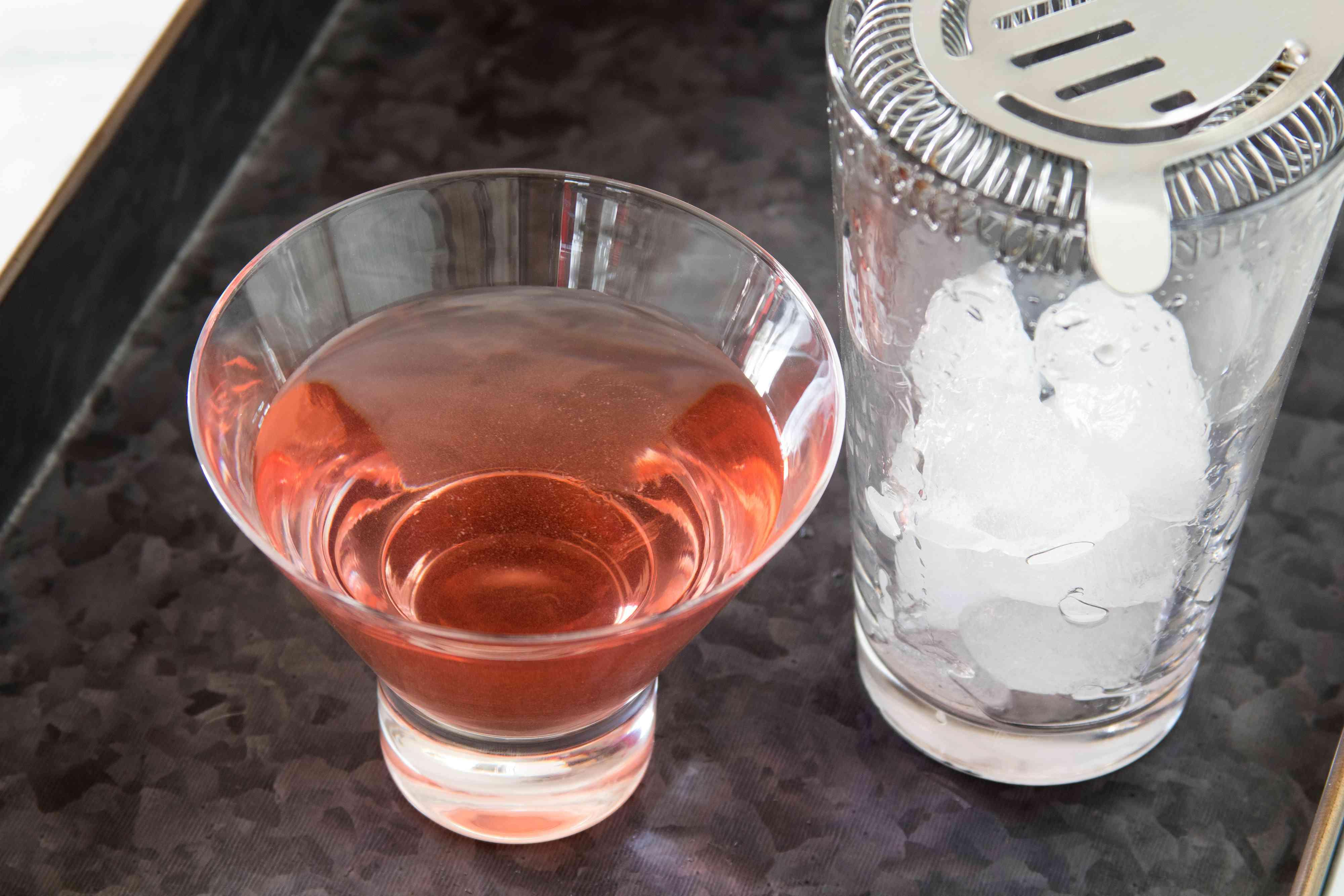Straining a Gummy Bear Martini