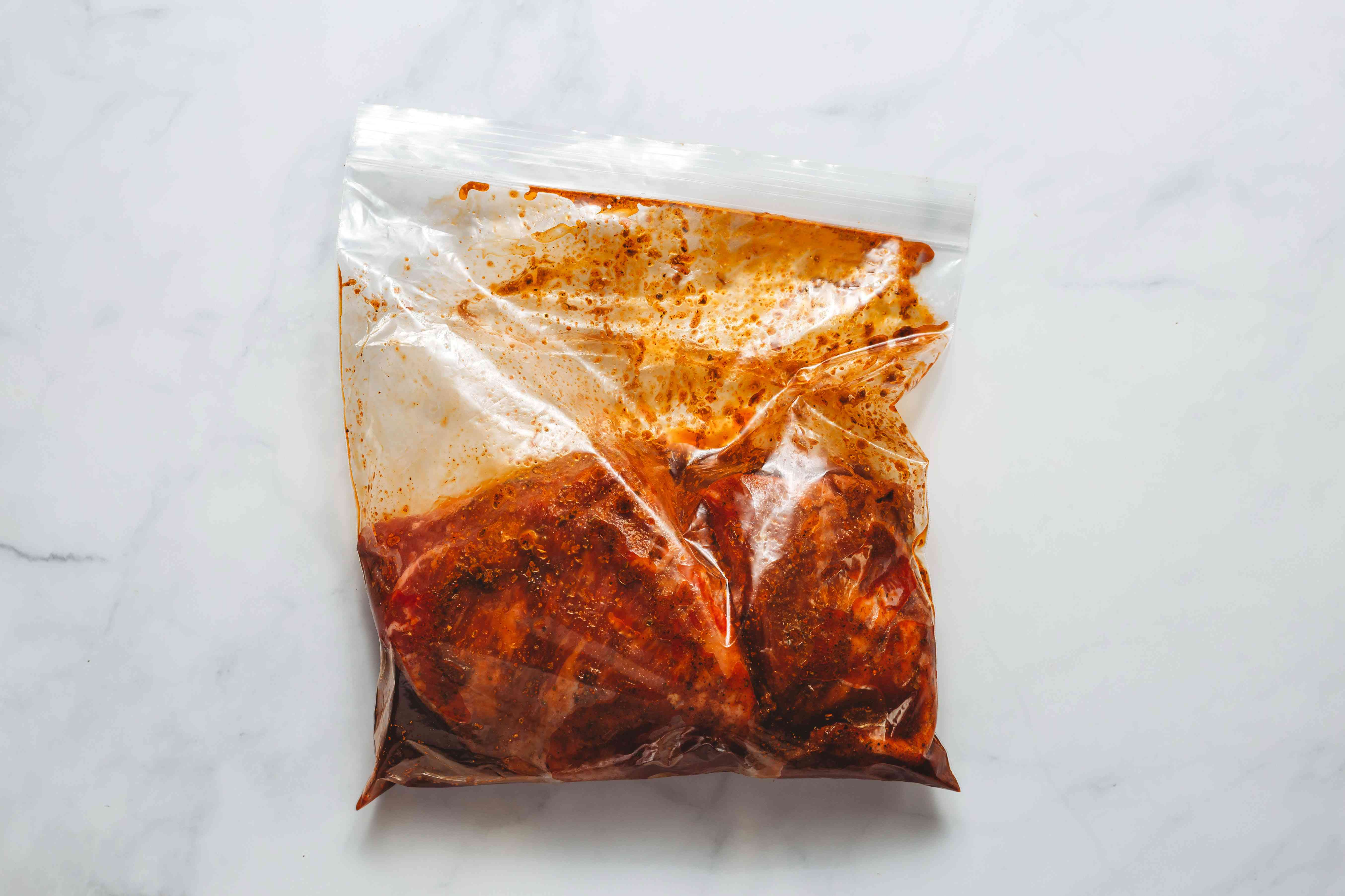 marinade and steak in a plastic bag