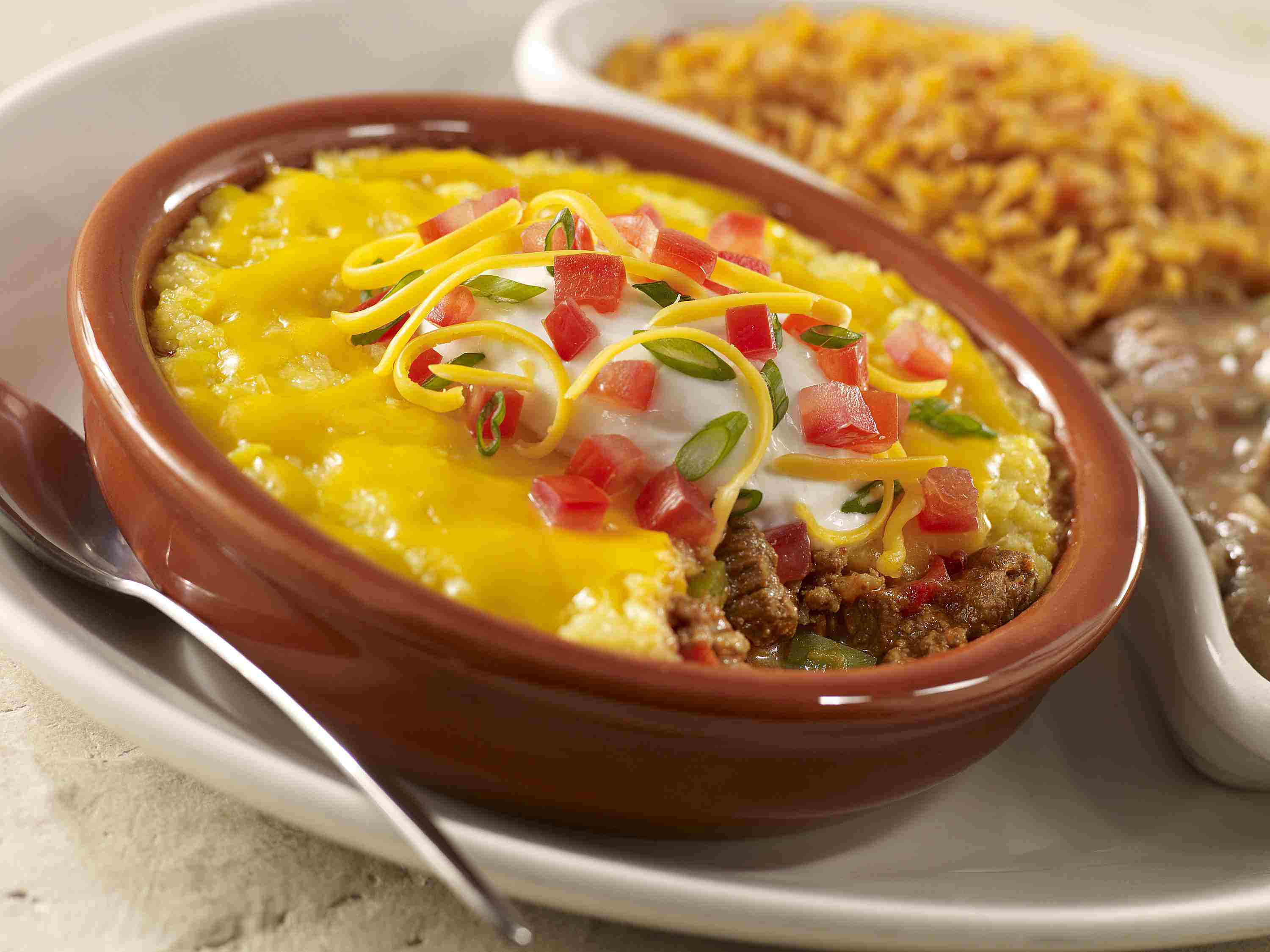 Crock pot beef tamale pie topped with a cheesy cornbread batter