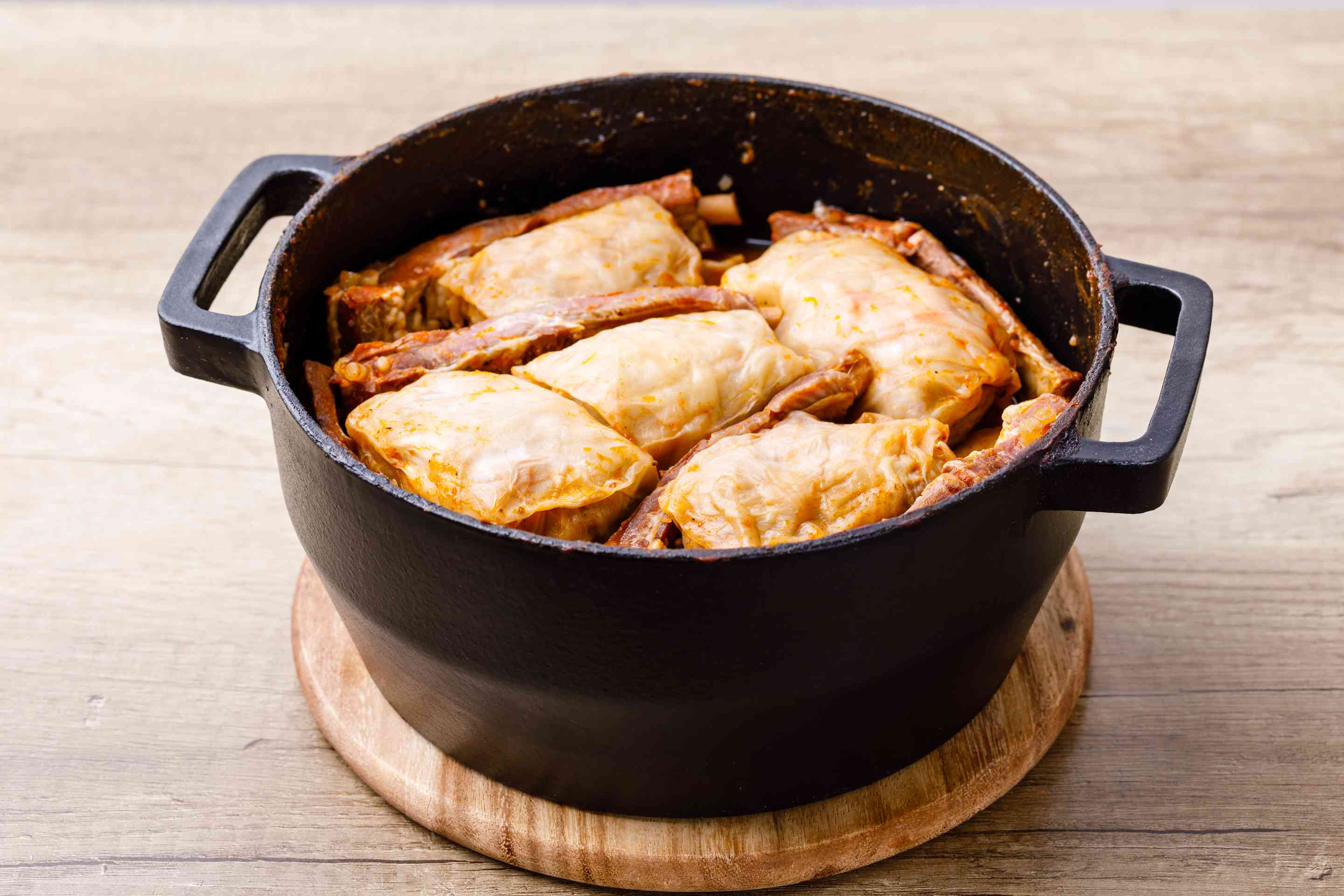 Cabbage rolls and ribs in a pot with leaves removed