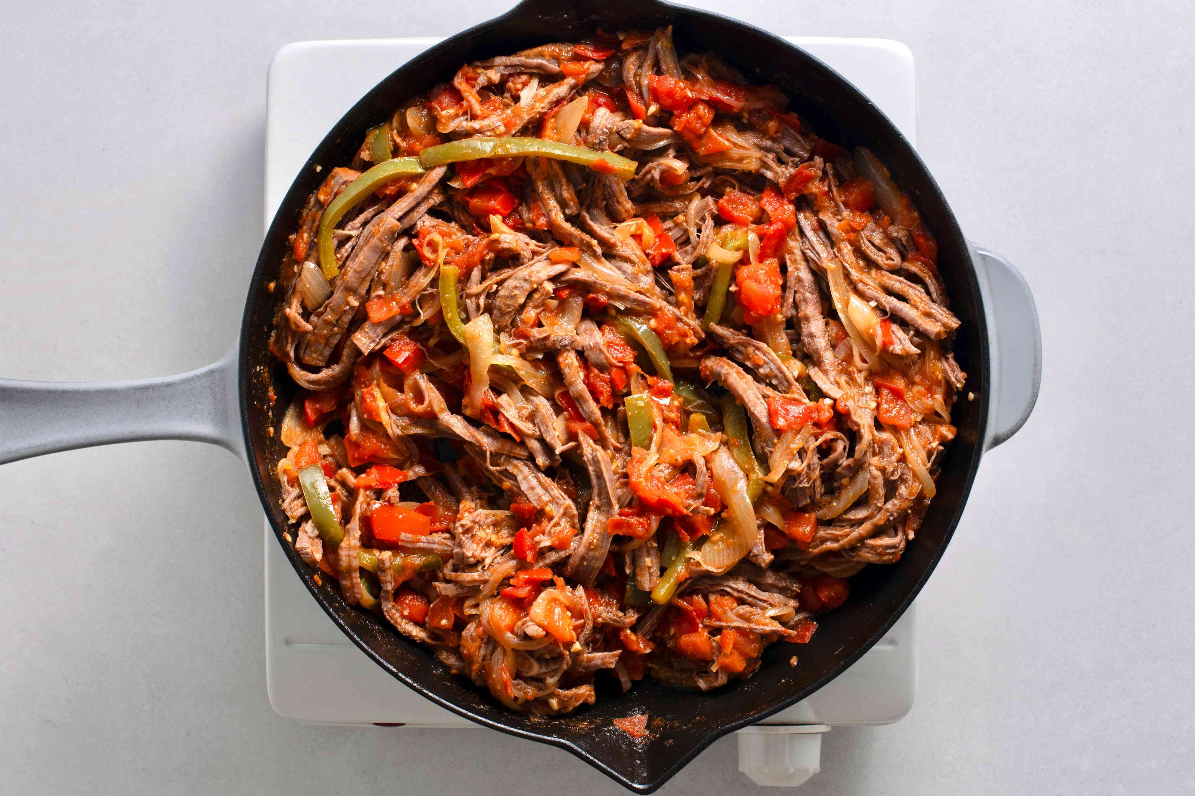 beef an vegetables cooking in a skillet