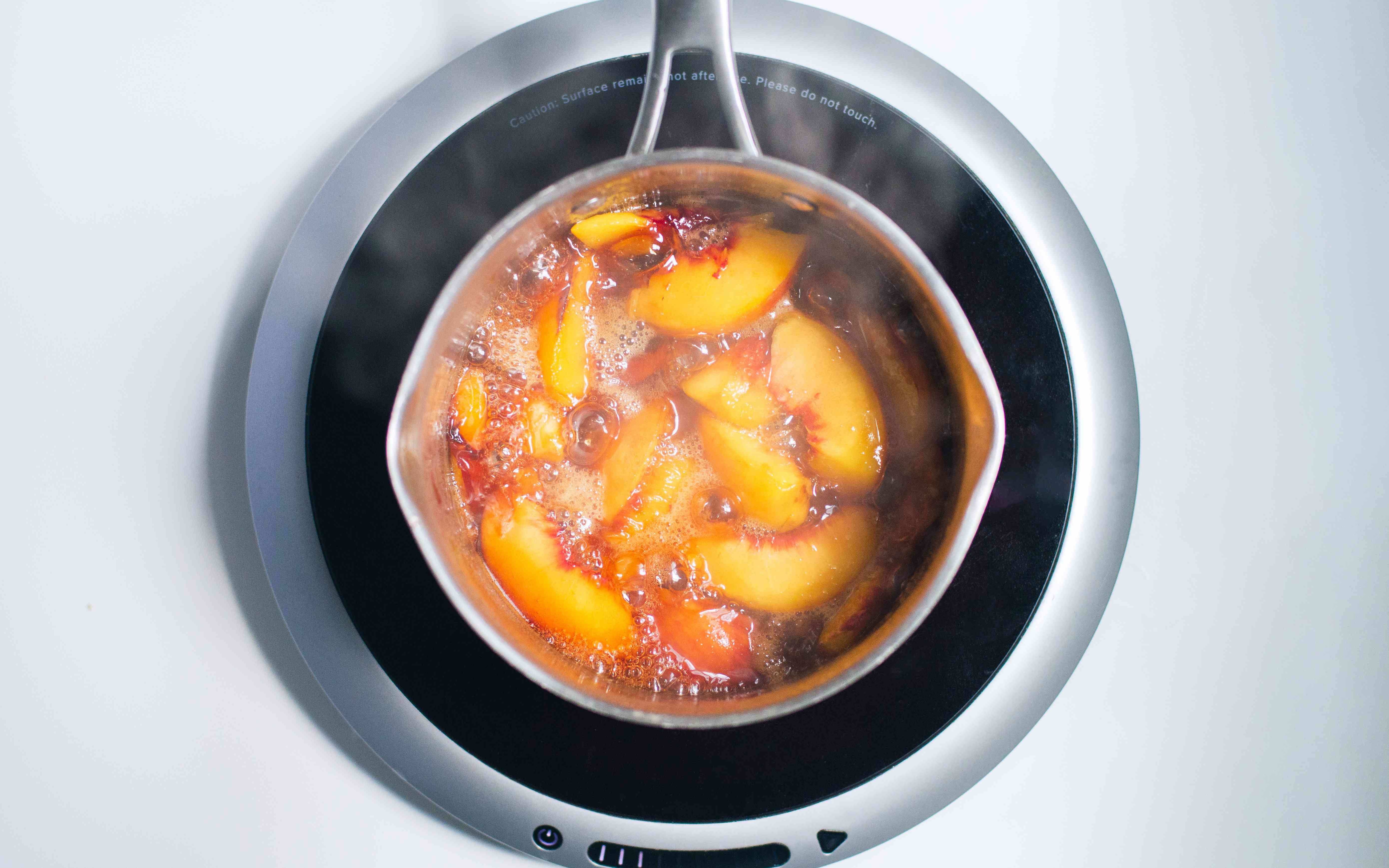 Combine peaches and brown sugar and cook