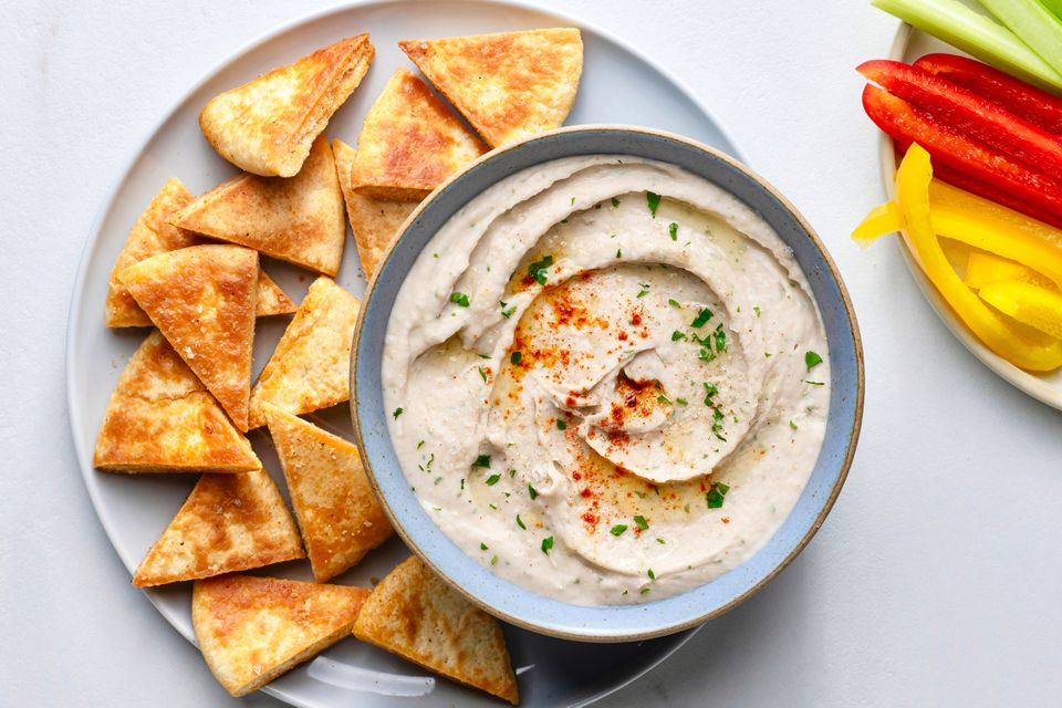 White Bean Hummus Dip (Gluten-free), served with pita chips and peppers