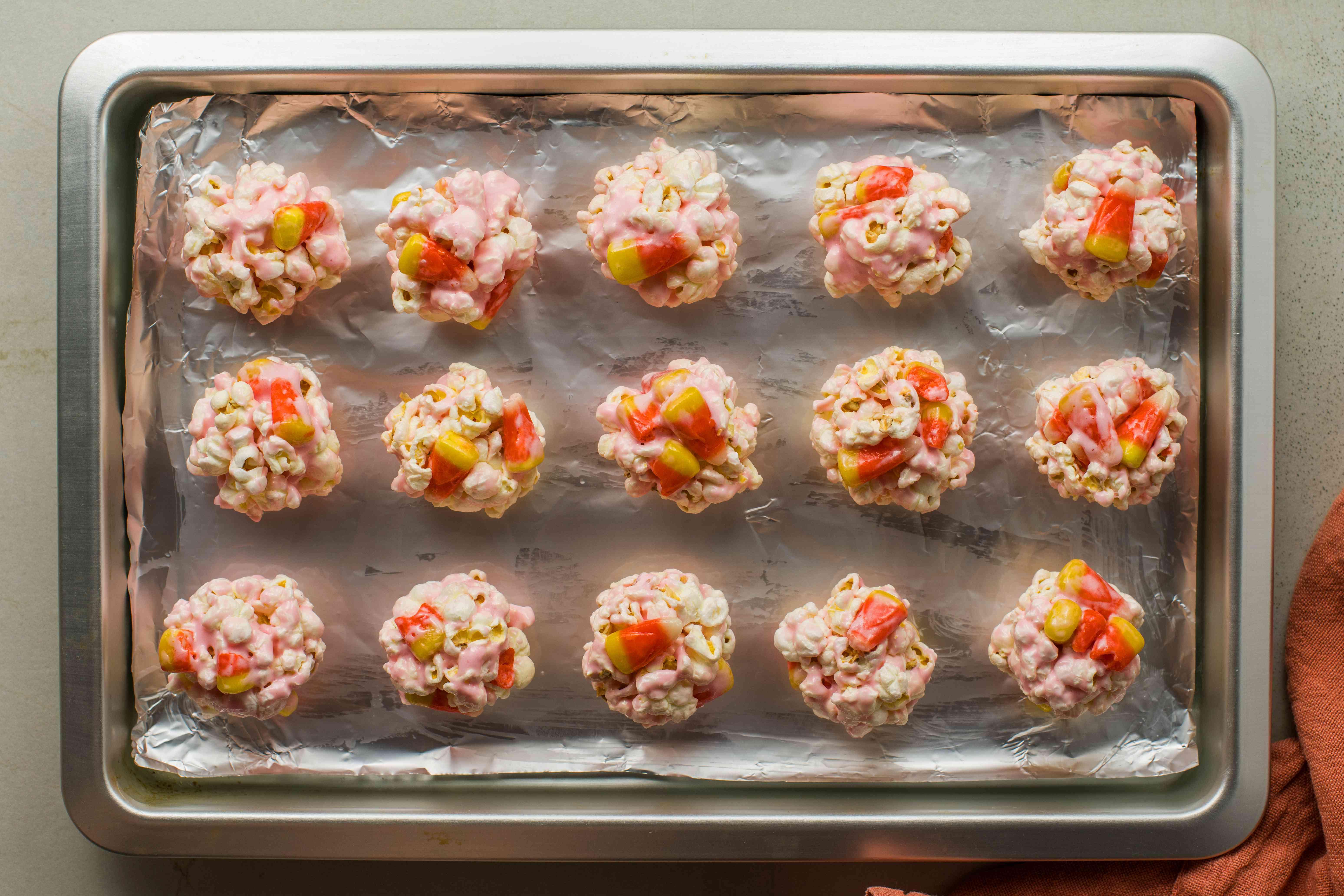 Place popcorn balls on tray