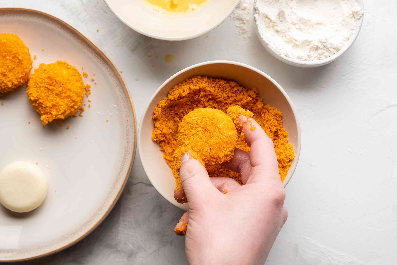 Coat the Babybels in egg wash, flour, and crushed Doritos