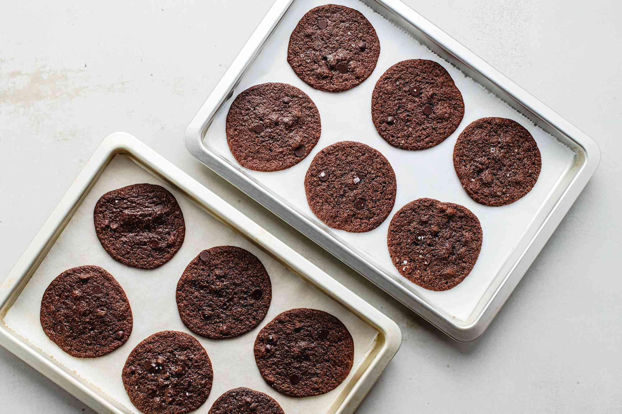 Baked keto chocolate cookies cooling on baking sheets