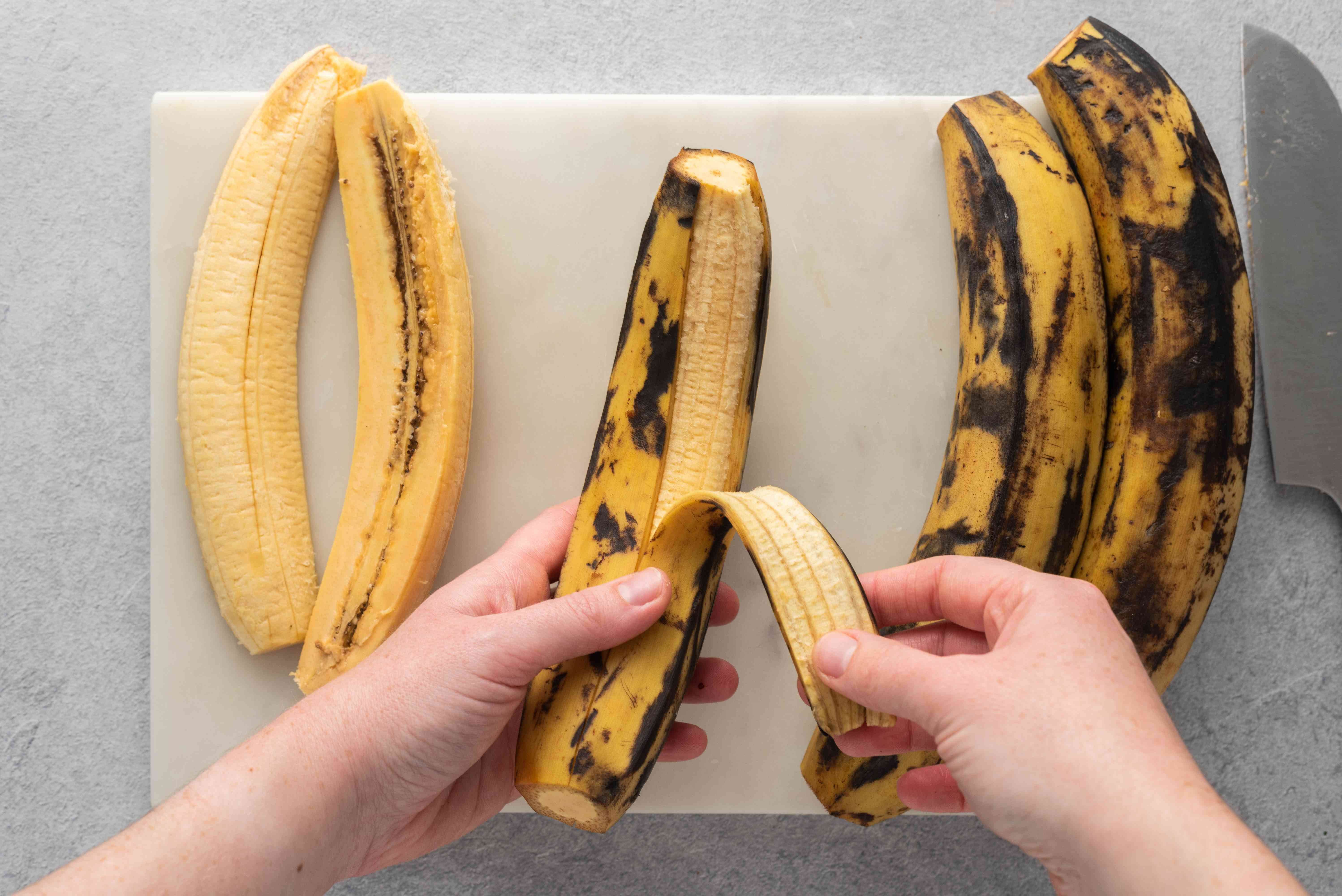 Peel the skin off the plantains, then slice each one in half lengthwise