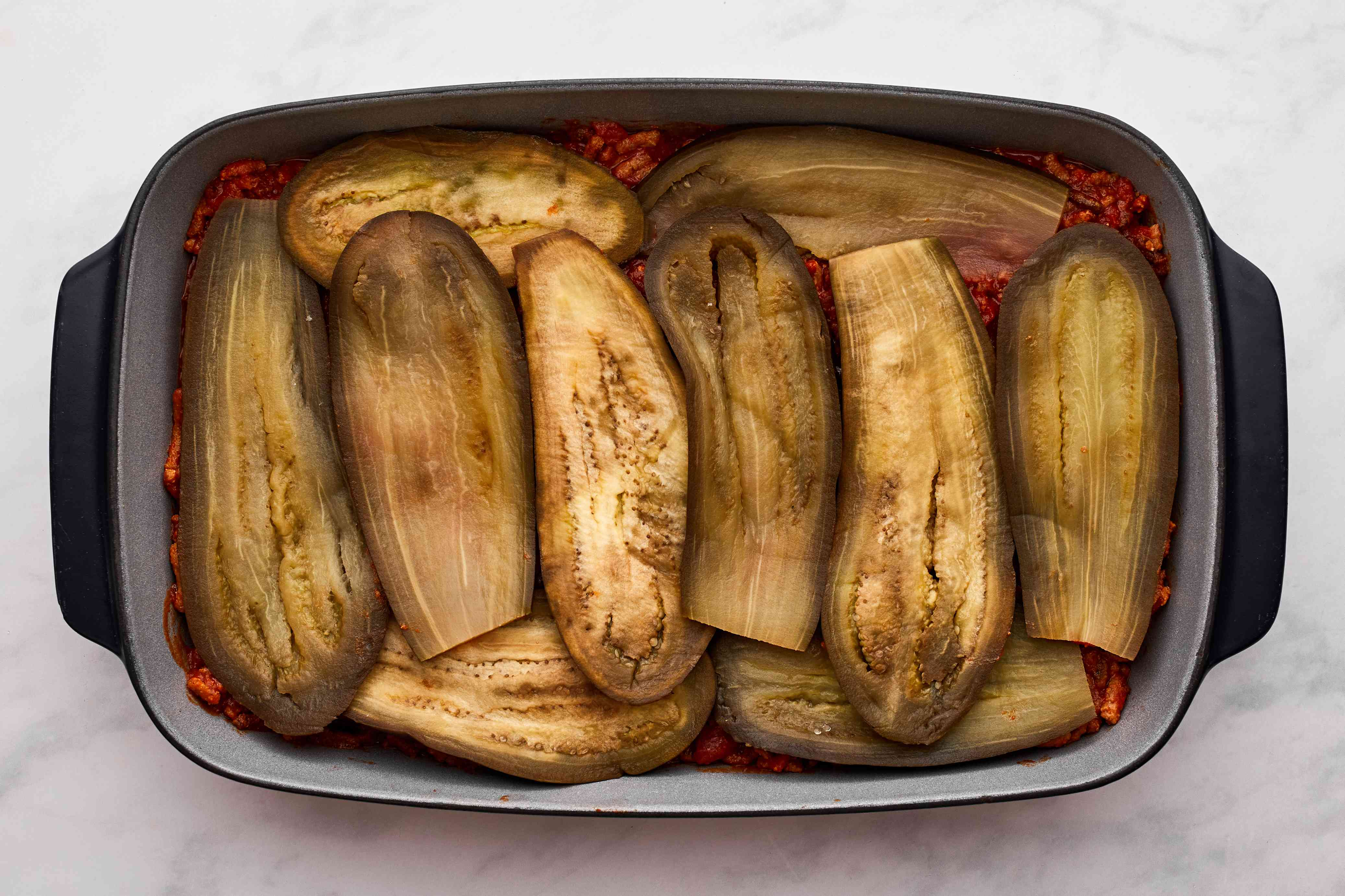 Top meat mixture with remaining eggplant slices
