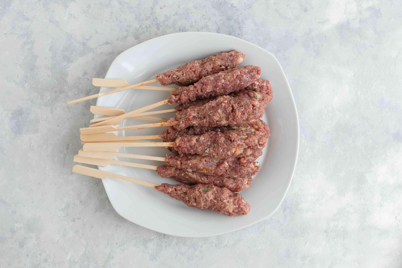 Divide meat onto sticks