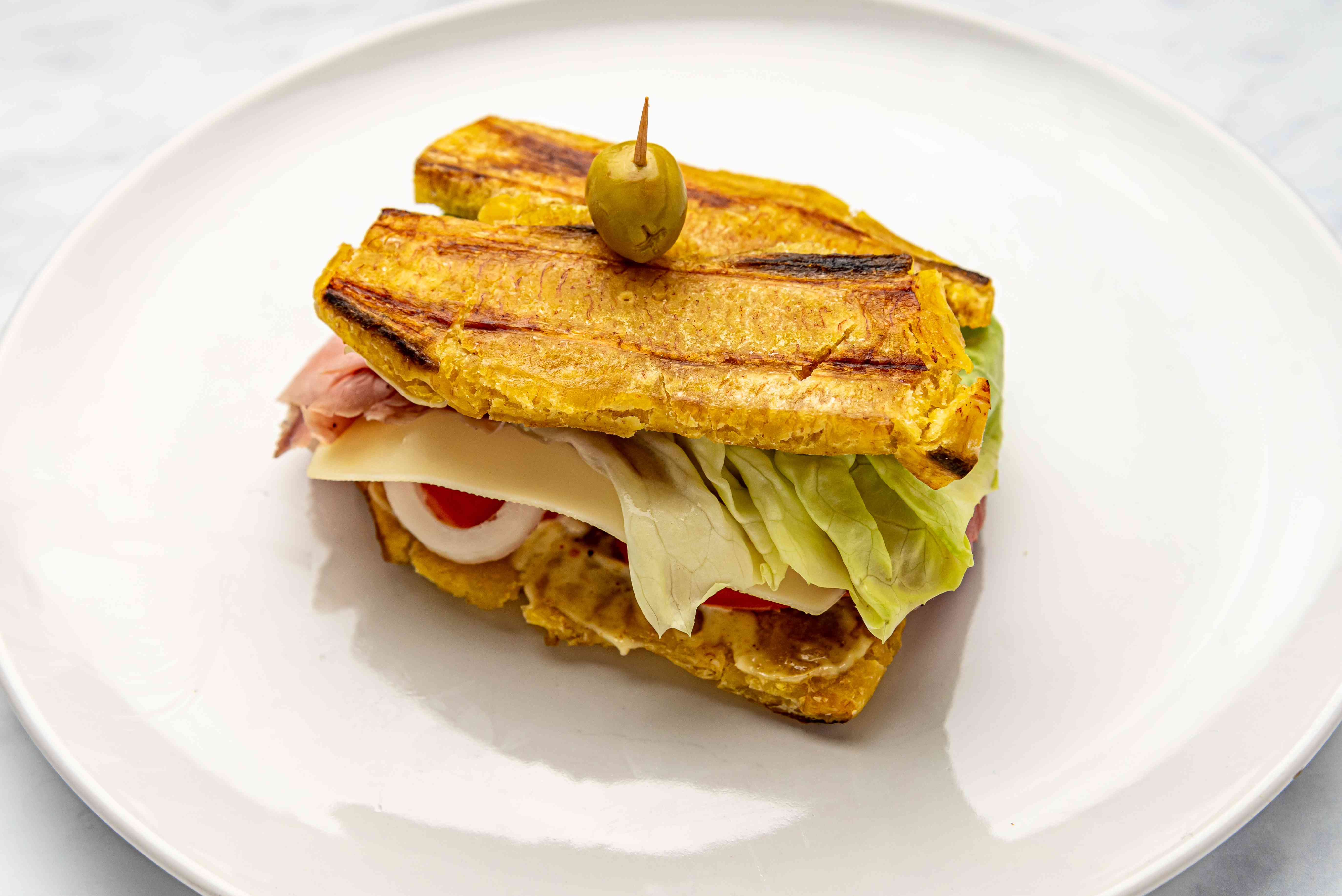 Smashed Plantain Sandwich (Jibarito) on a plate