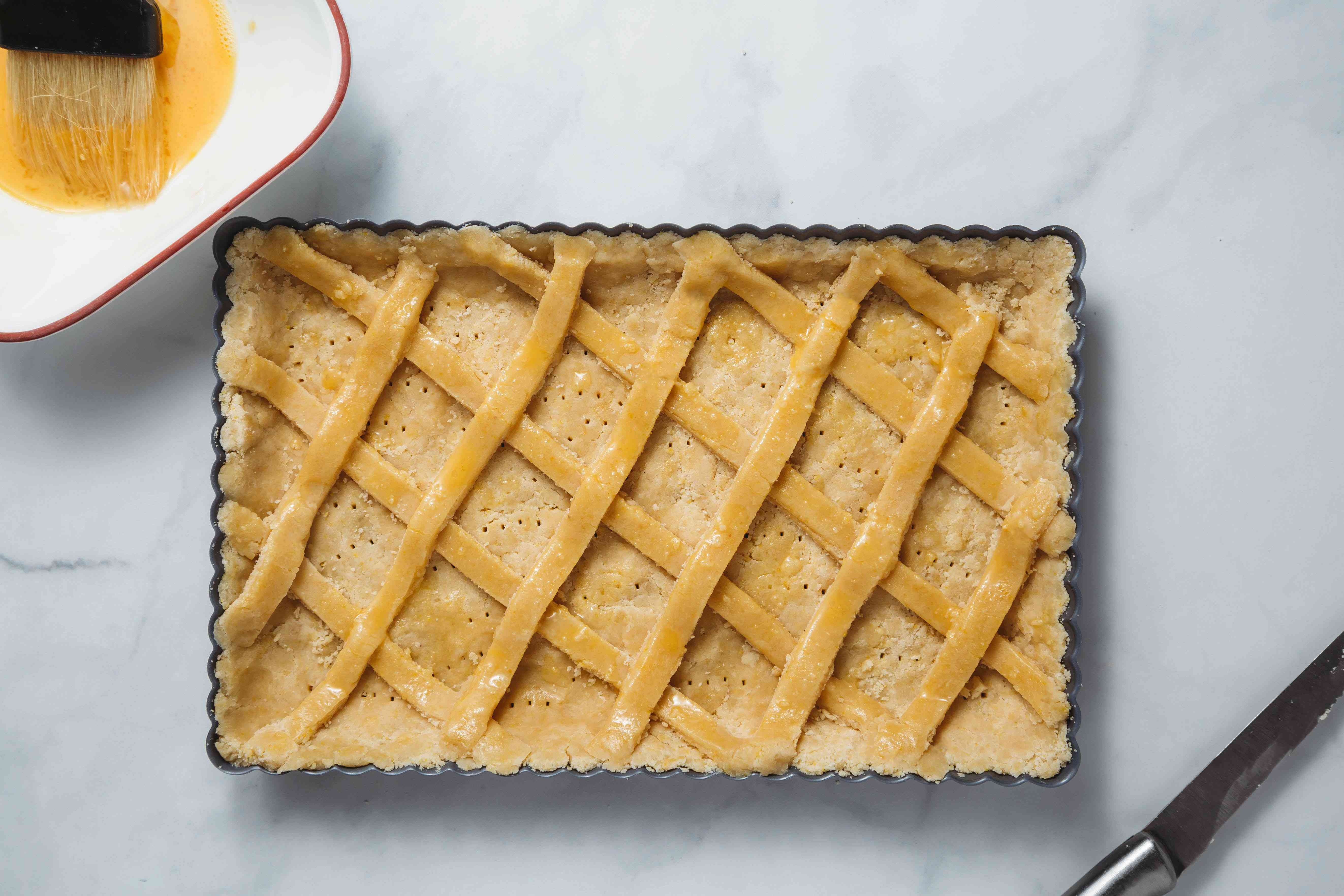 lattice of dough in tart pan