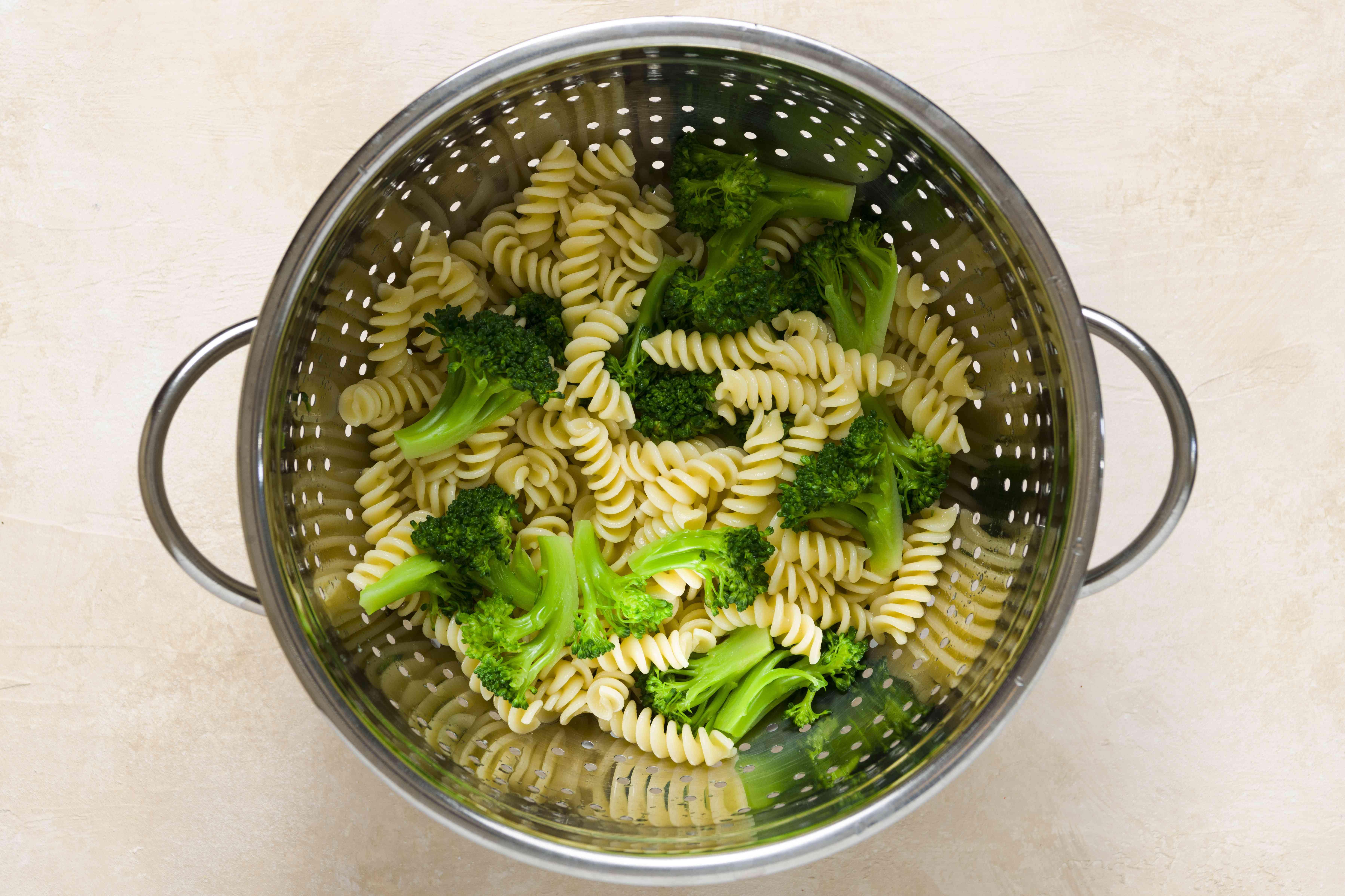 pasta and broccoli in a colander