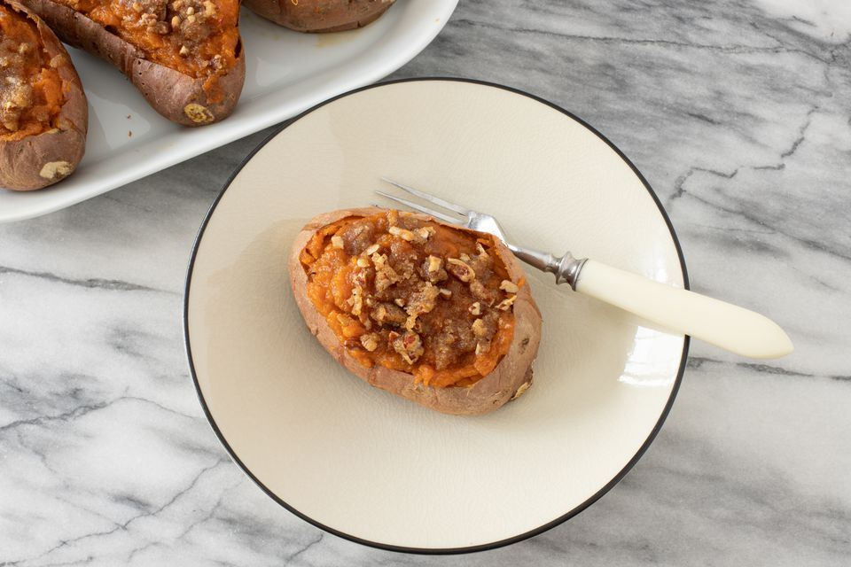 Twice-baked sweet potato on a plate with fork
