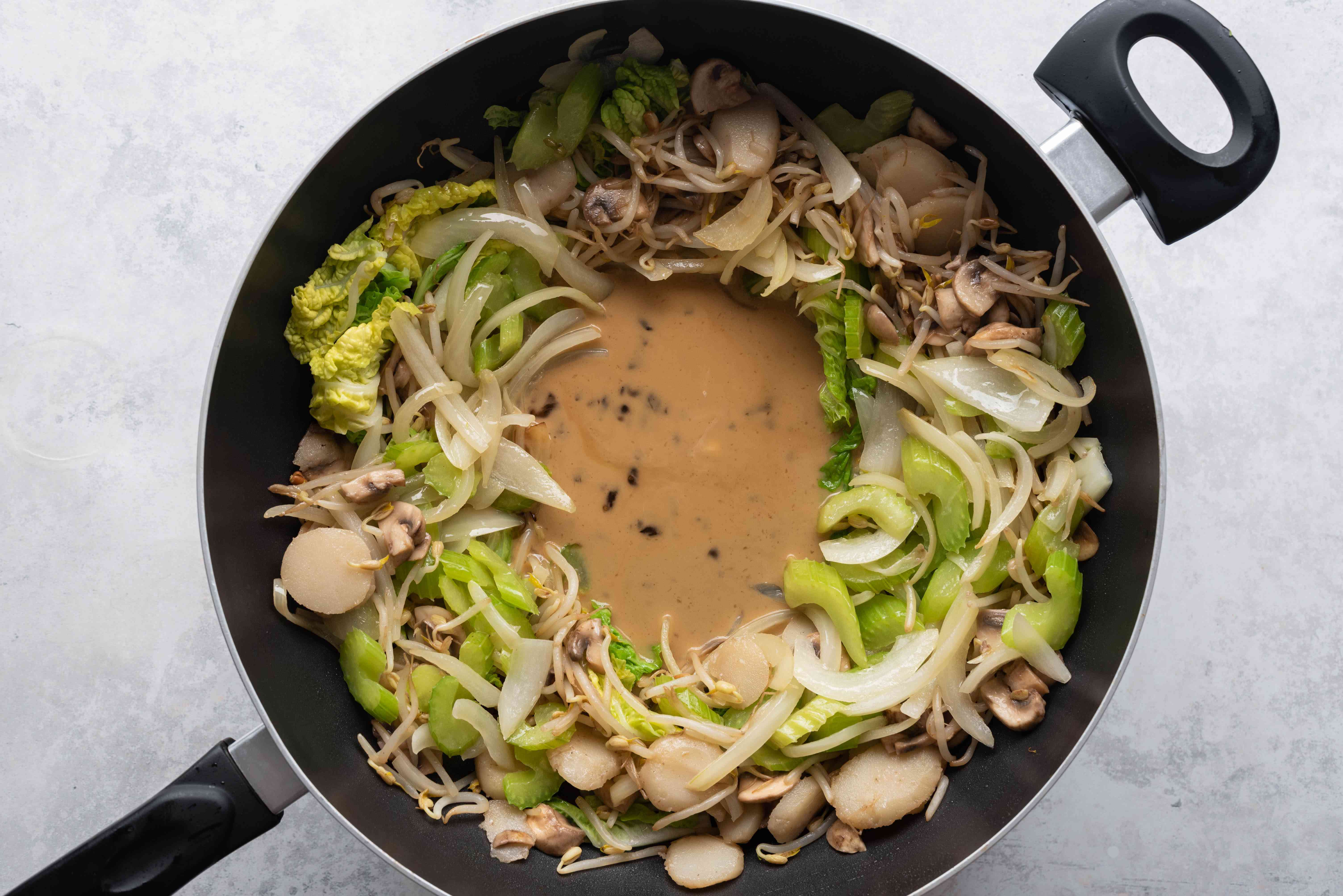 add sauce to the vegetables in the pan