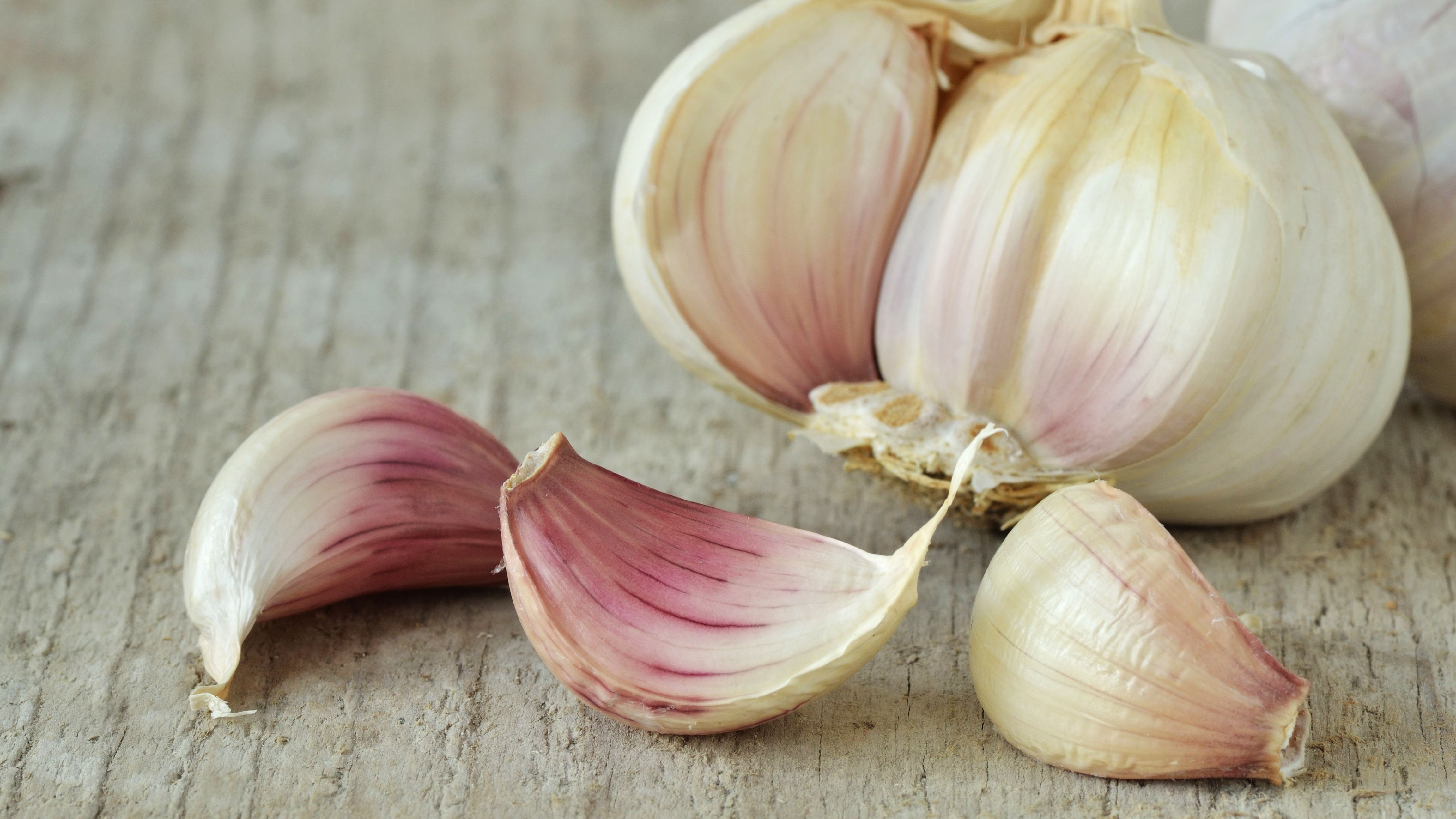 5 Swaps for Fresh Garlic Cloves  Natural remedies for pimples close up of garlic on table 760254411 5bcbf91c4cedfd0026f2b89d