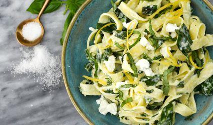 Goat cheese pasta serving with lemon and basil garnish..