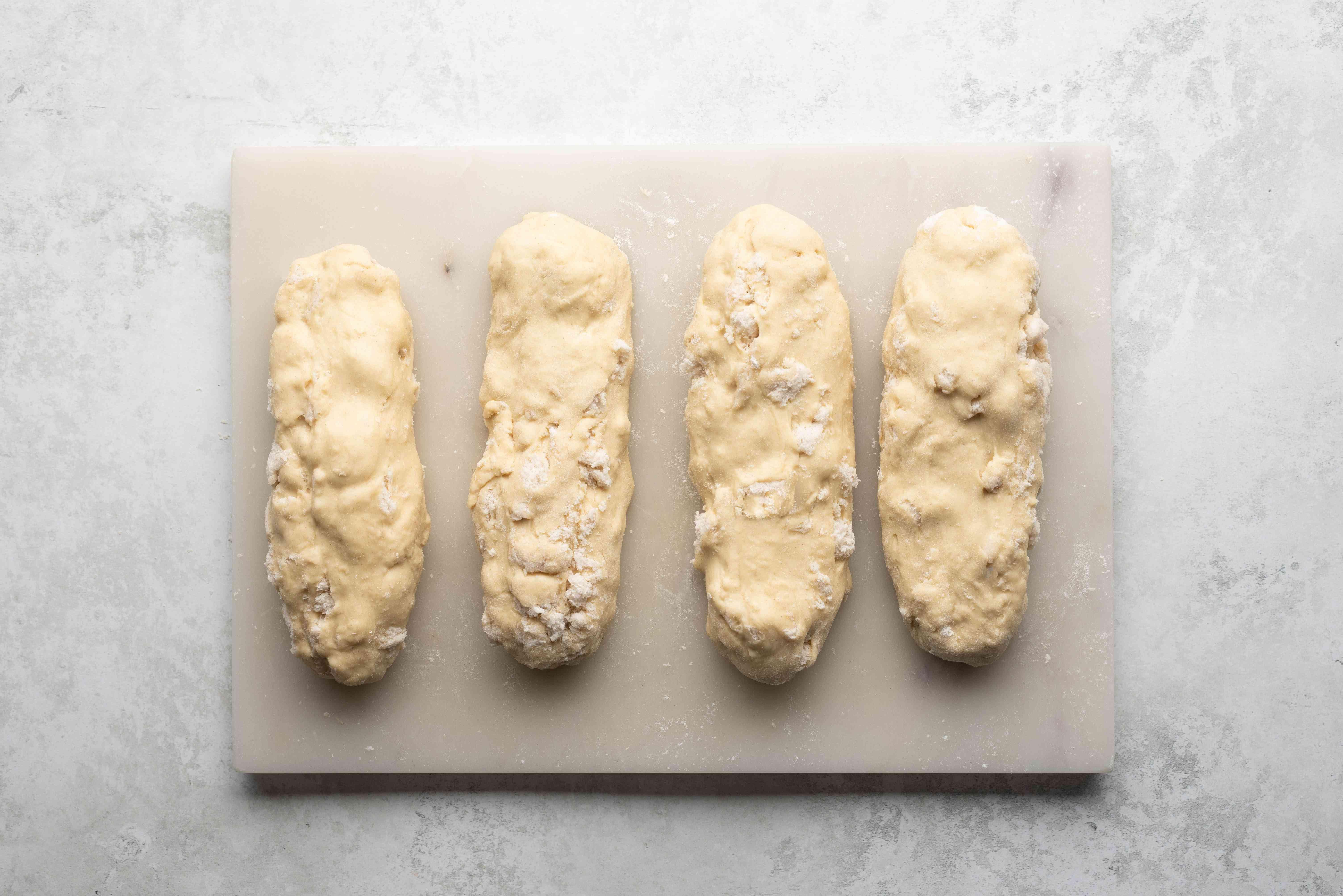 Dough shaped into four rolls