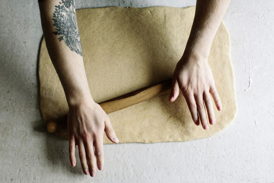 hands rolling out dough