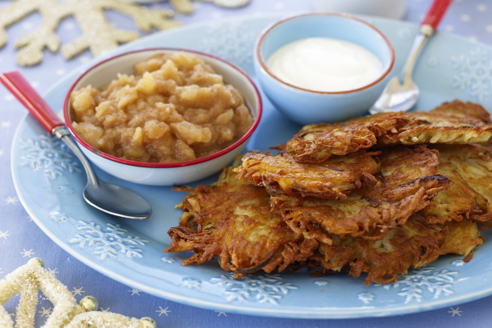Latkes on a plate with applesauce