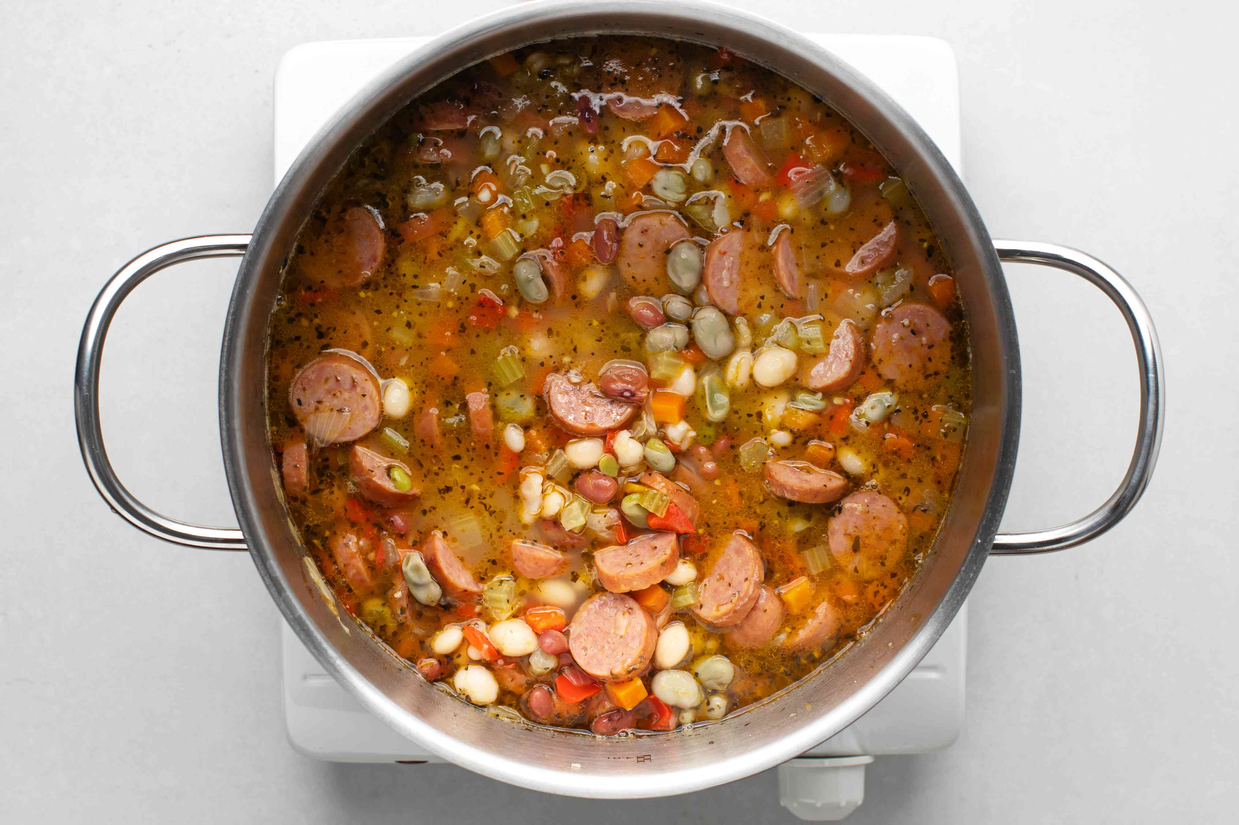 add drained beans to the soup in the pot