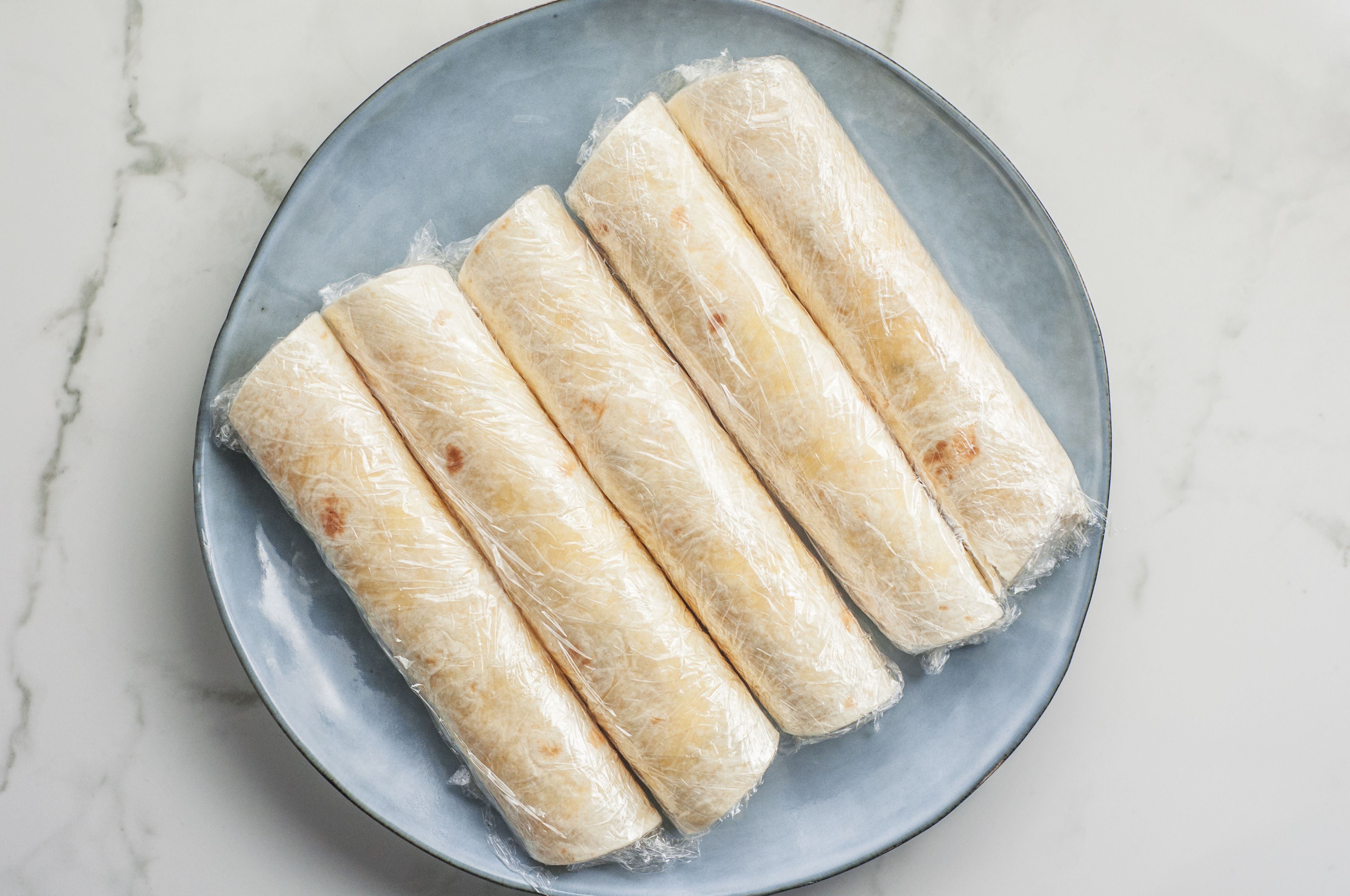 Tortillas rolled and wrapped in plastic