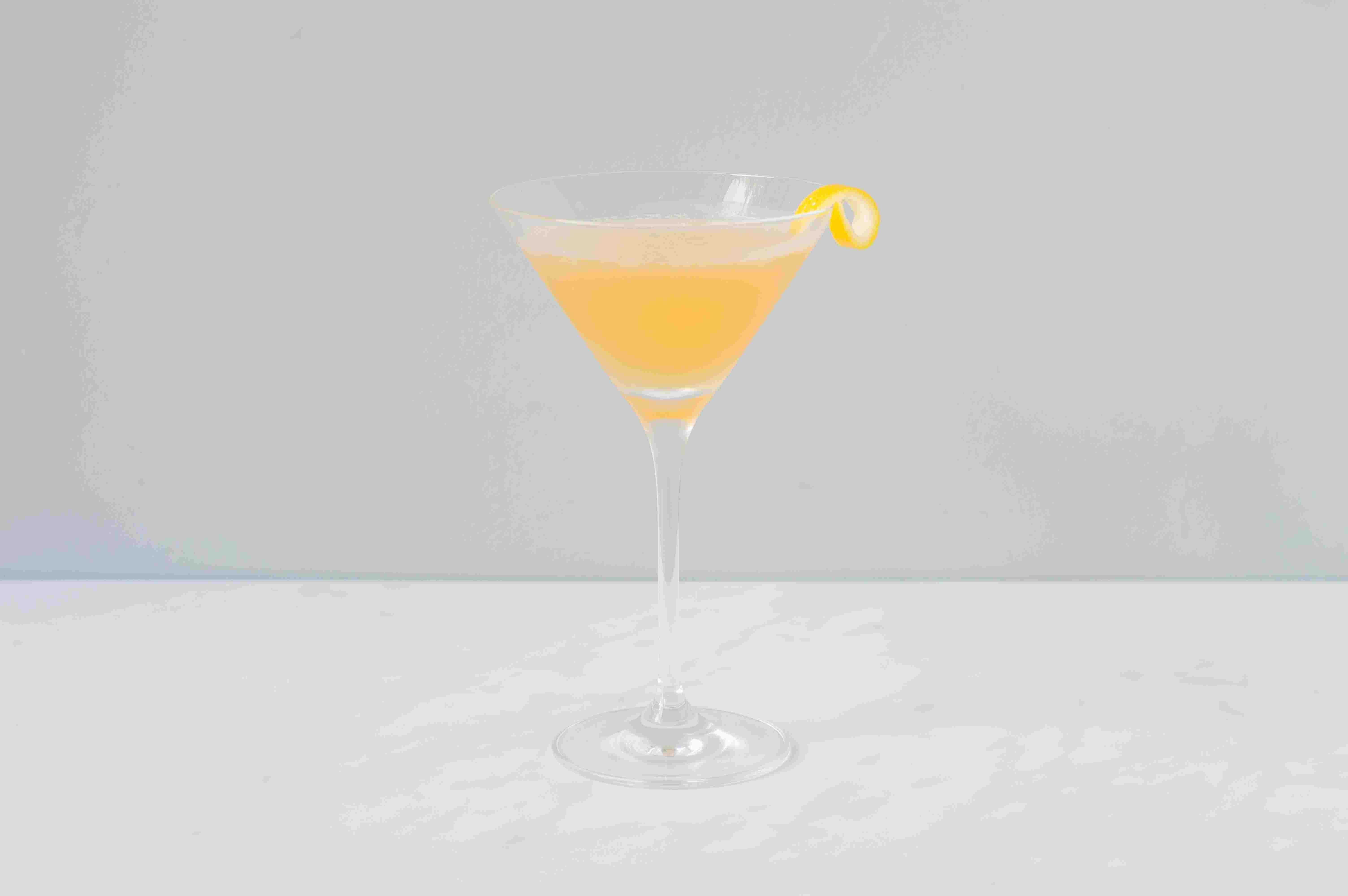 Classic sidecar cocktail with a lemon twist