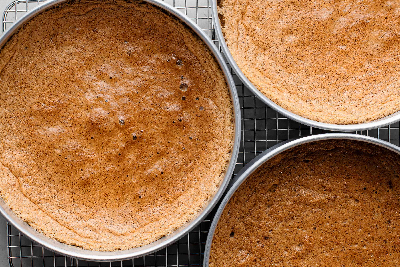 walnut torte sponge in baking pans cooling on a wire rack