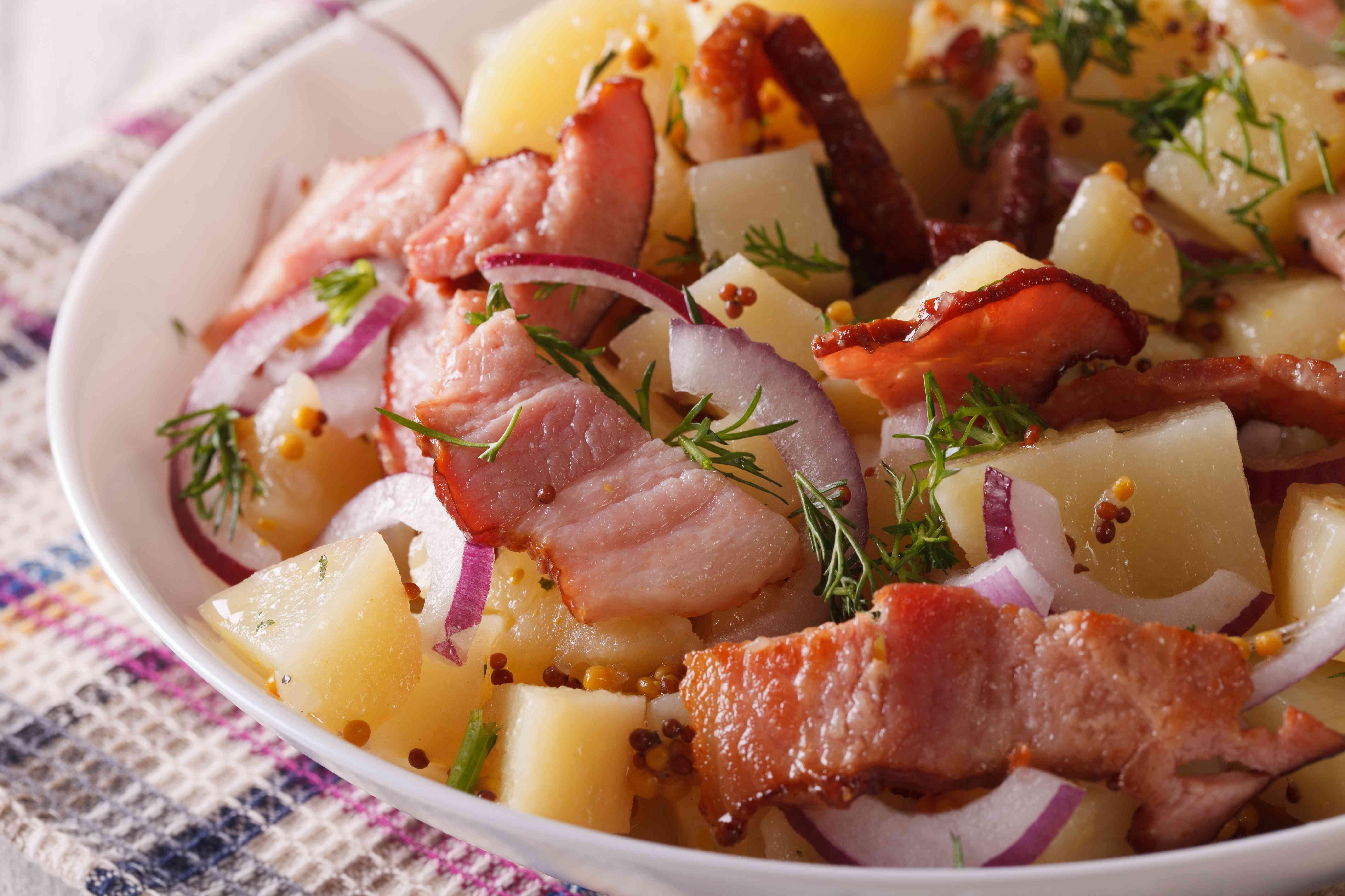 potato salad with bacon on a plate macro. horizontal