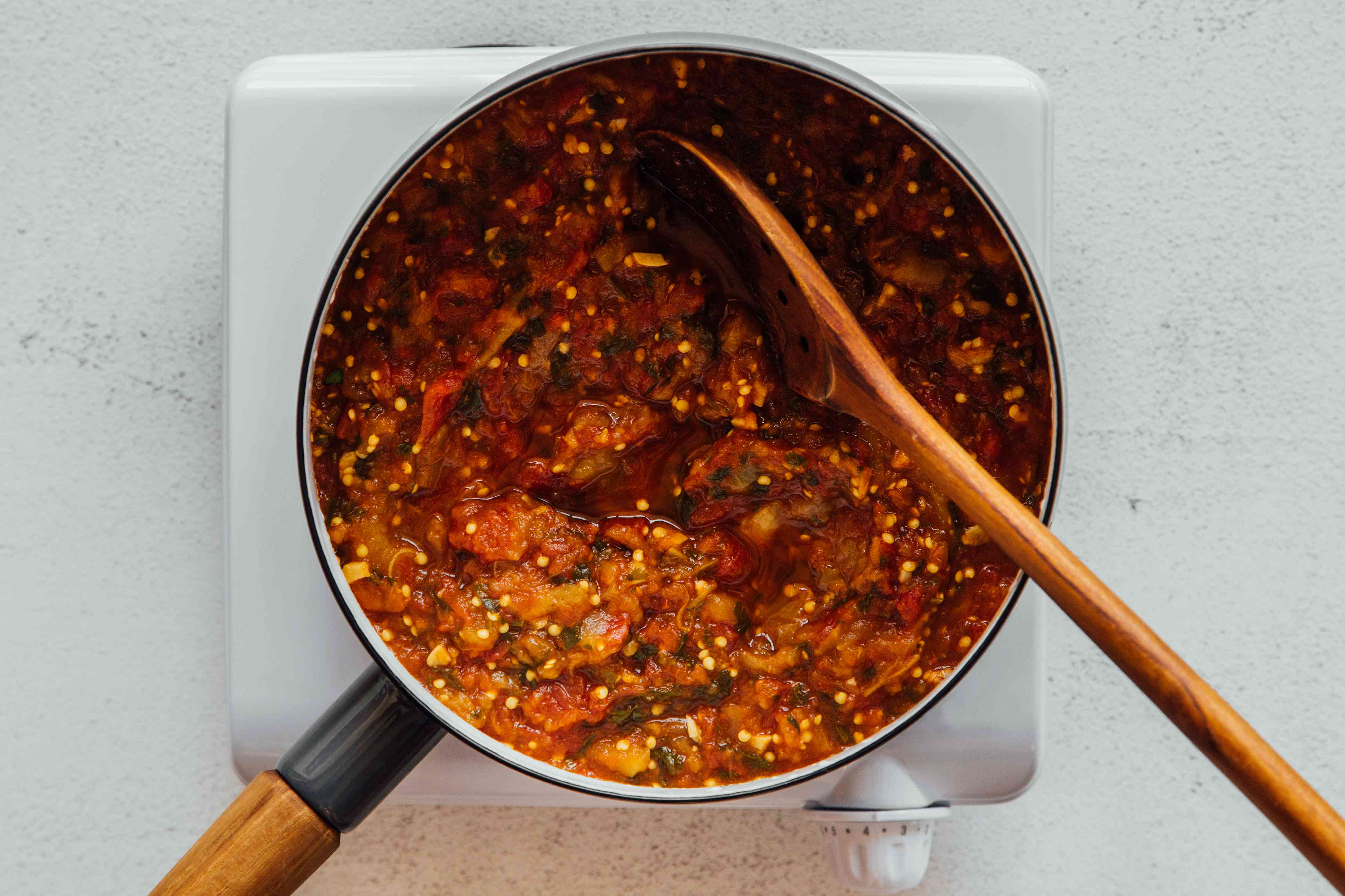 Tomato and eggplant mixture cooking in a pan